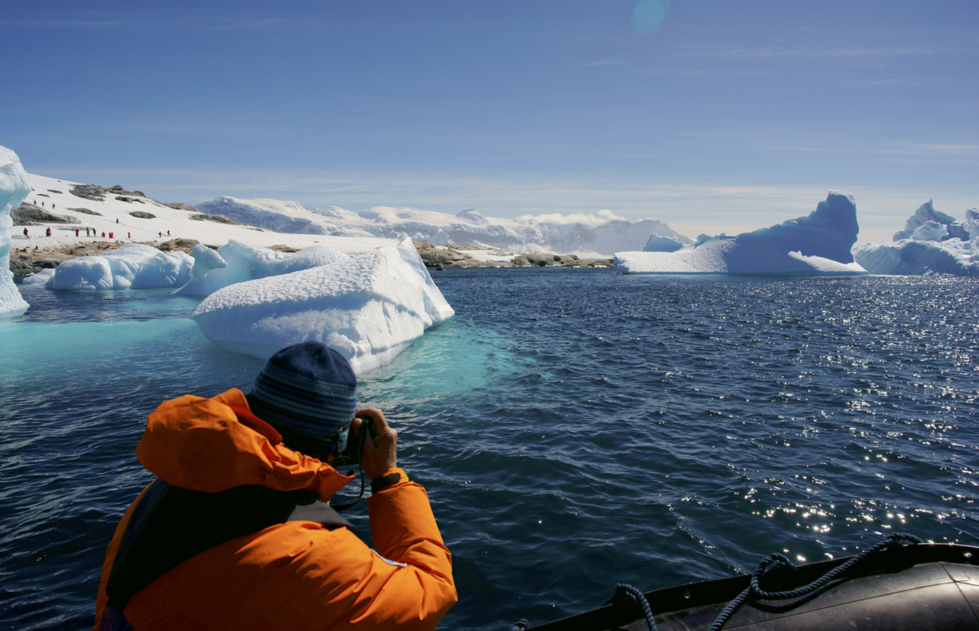 Tourist viewing an iceberg in Antarctica
