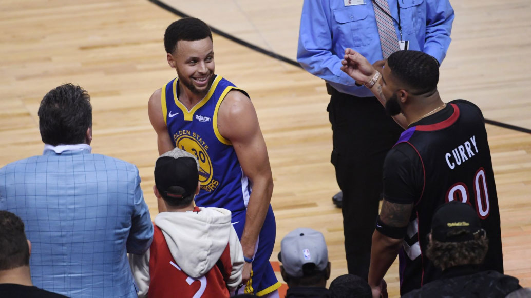 Drake and Steph Curry exchange words.