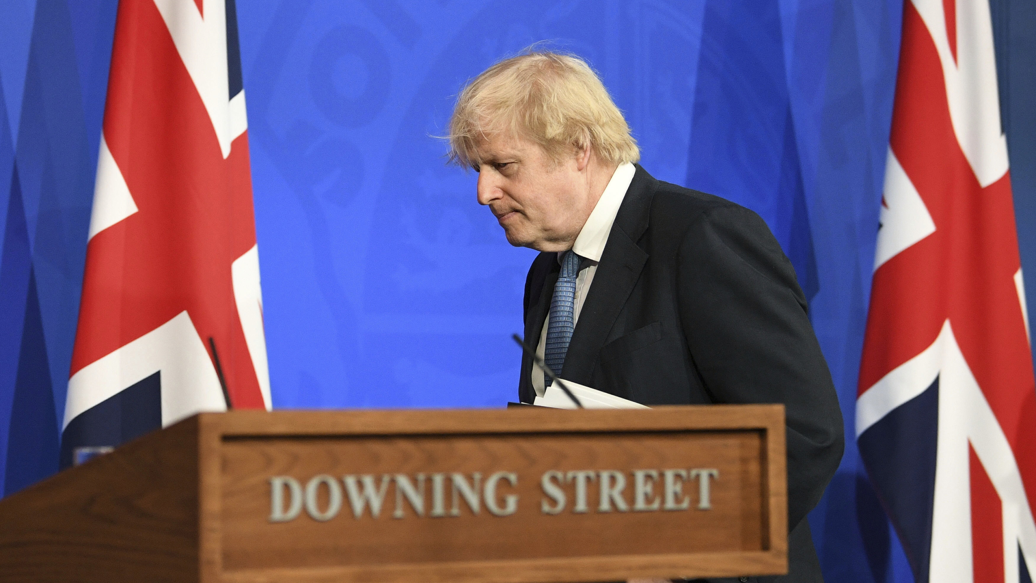 Britain's Prime Minister Boris Johnson leaves, after a coronavirus briefing in Downing Street, London