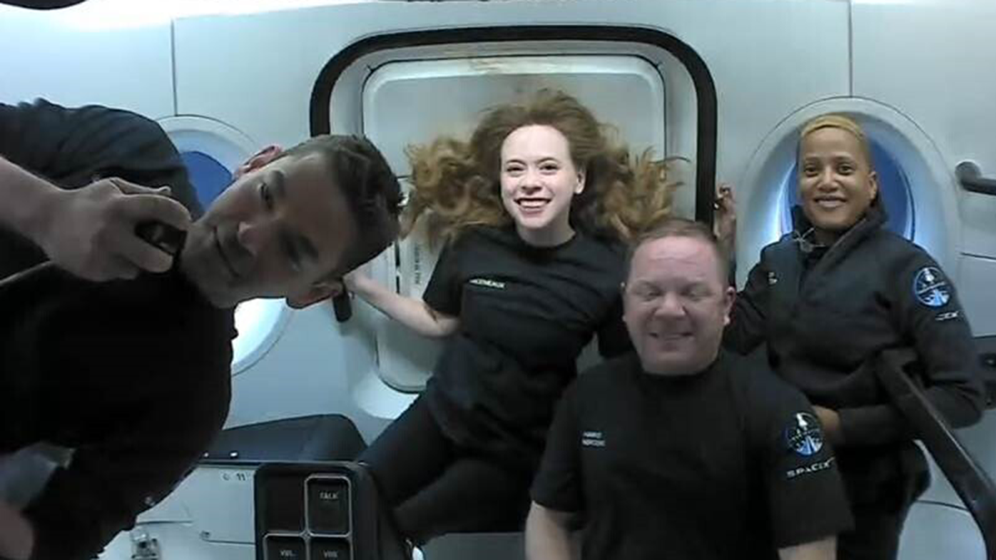 This photo provided by SpaceX shows the passengers of Inspiration4 in the Dragon capsule on their first day in space. They are, from left, Jared Isaacman, Hayley Arceneaux, Chris Sembroski and Sian Proctor. SpaceX got them into a 363-mile (585-kilometre) orbit following Wednesday night's launch from NASA's Kennedy Space Center. That's 100 miles (160 kilometres) higher than the International Space Station.