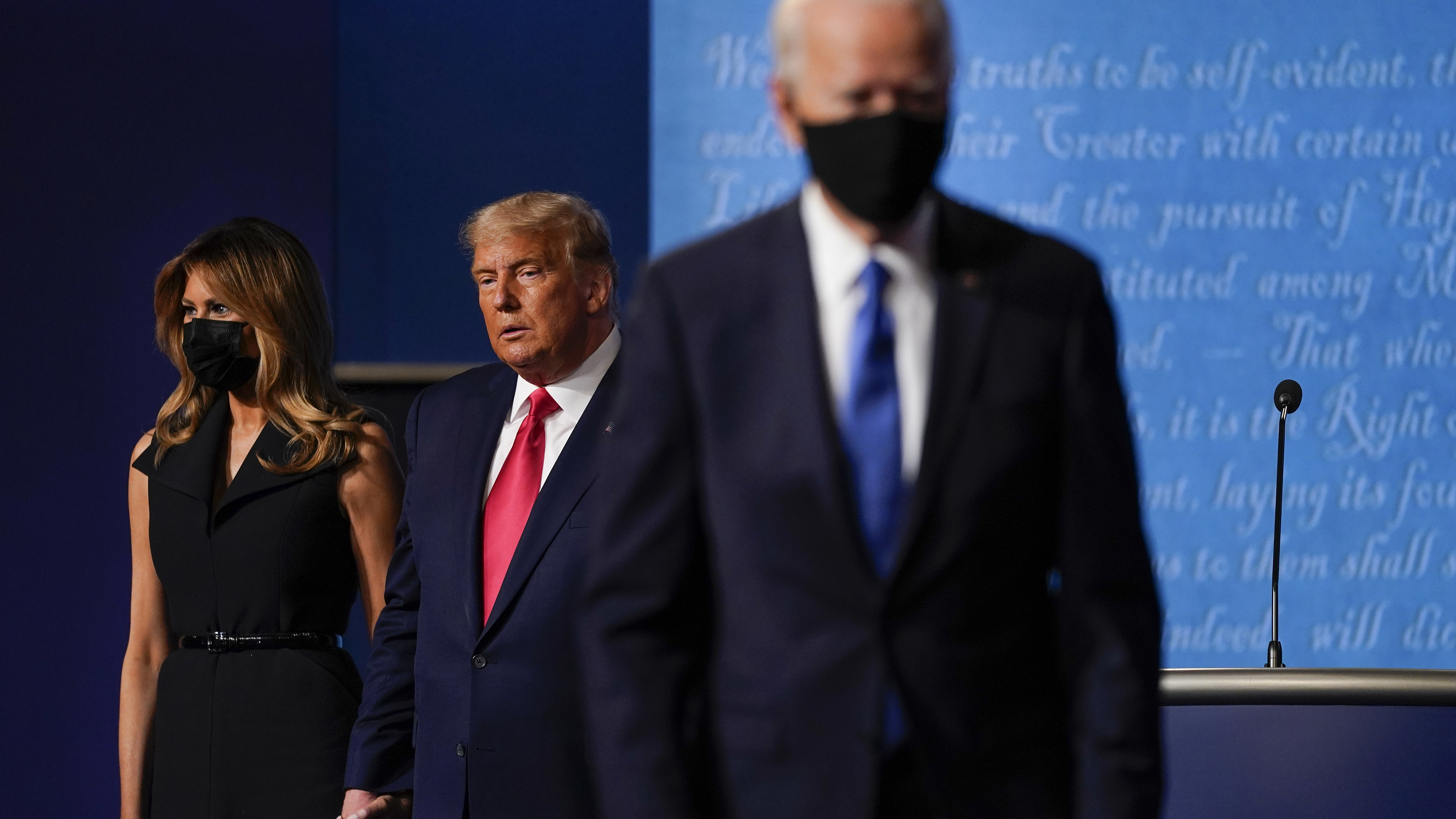 In this photo from October last year, First lady Melania Trump, left, and President Donald Trump, centre, remain on stage as Democratic presidential candidate former Vice President Joe Biden, right, walks away at the conclusion of the second and final presidential debate at Belmont University in Nashville.