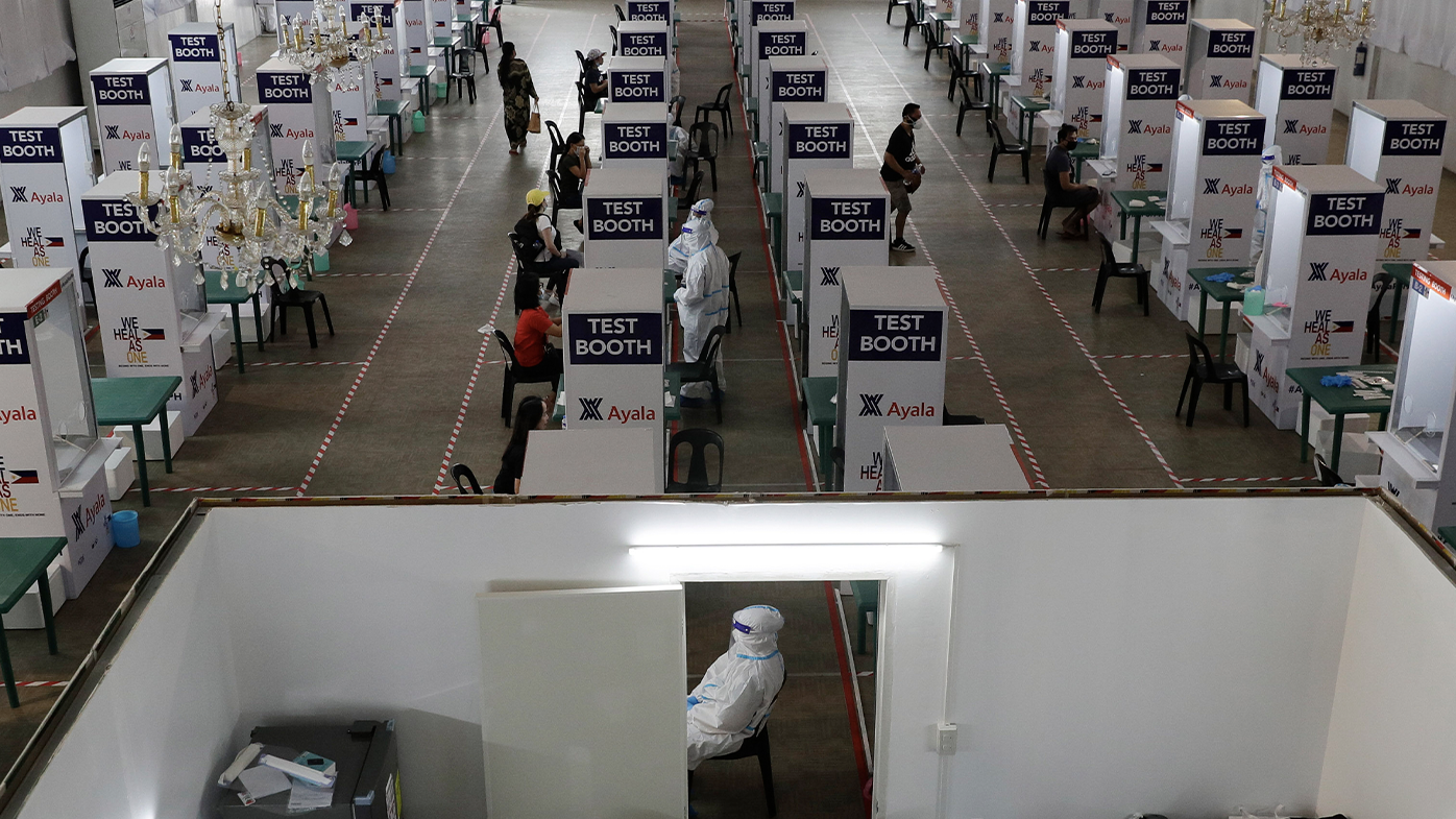 Health workers perform testing at a COVID-19 testing center at the Palacio de Manila during an enhanced community quarantine to prevent the spread of the new coronavirus on Monday, May 11, 2020. (AP Photo/Aaron Favila)