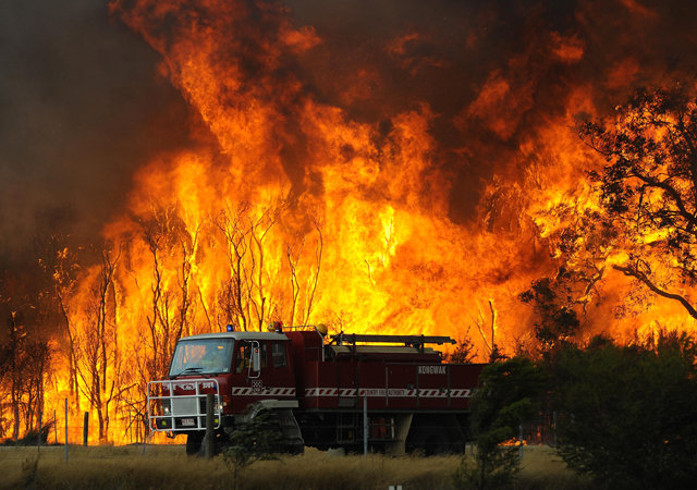 A 2009 file photo showing fire fighters battling bushfires at the Bunyip State Forest near the township of Tonimbuk, Victoria. The Black Saturday bushfires claimed the lives of at least 173 people.
