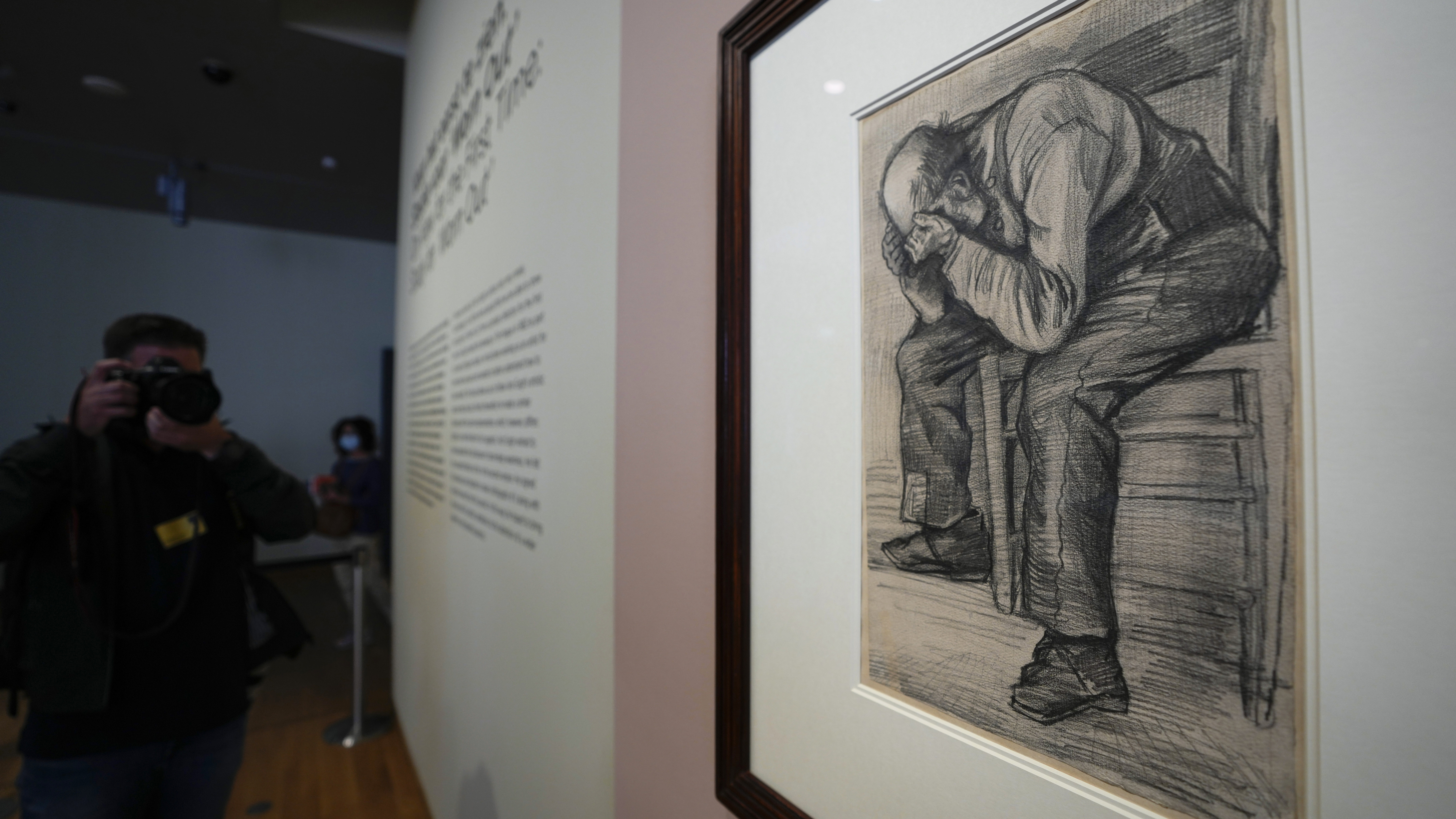 """A photographer takes pictures of Study for """"Worn Out"""", a drawing by Dutch master Vincent van Gogh, dated Nov. 1882, on public display for the first time at the Van Gogh Museum in Amsterdam."""