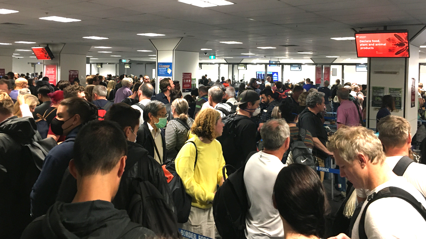 Sydney's airport is jammed with frustrated passengers who landed hours after Australia's tough new coronavirus travel measures were rolled out.