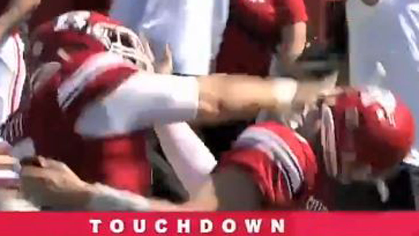 QB punched in face by teammate after touchdown