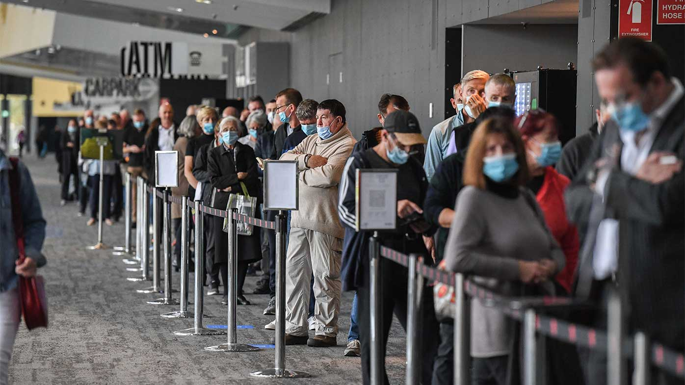 People queue up to receive the coronavirus vaccine in Melbourne.