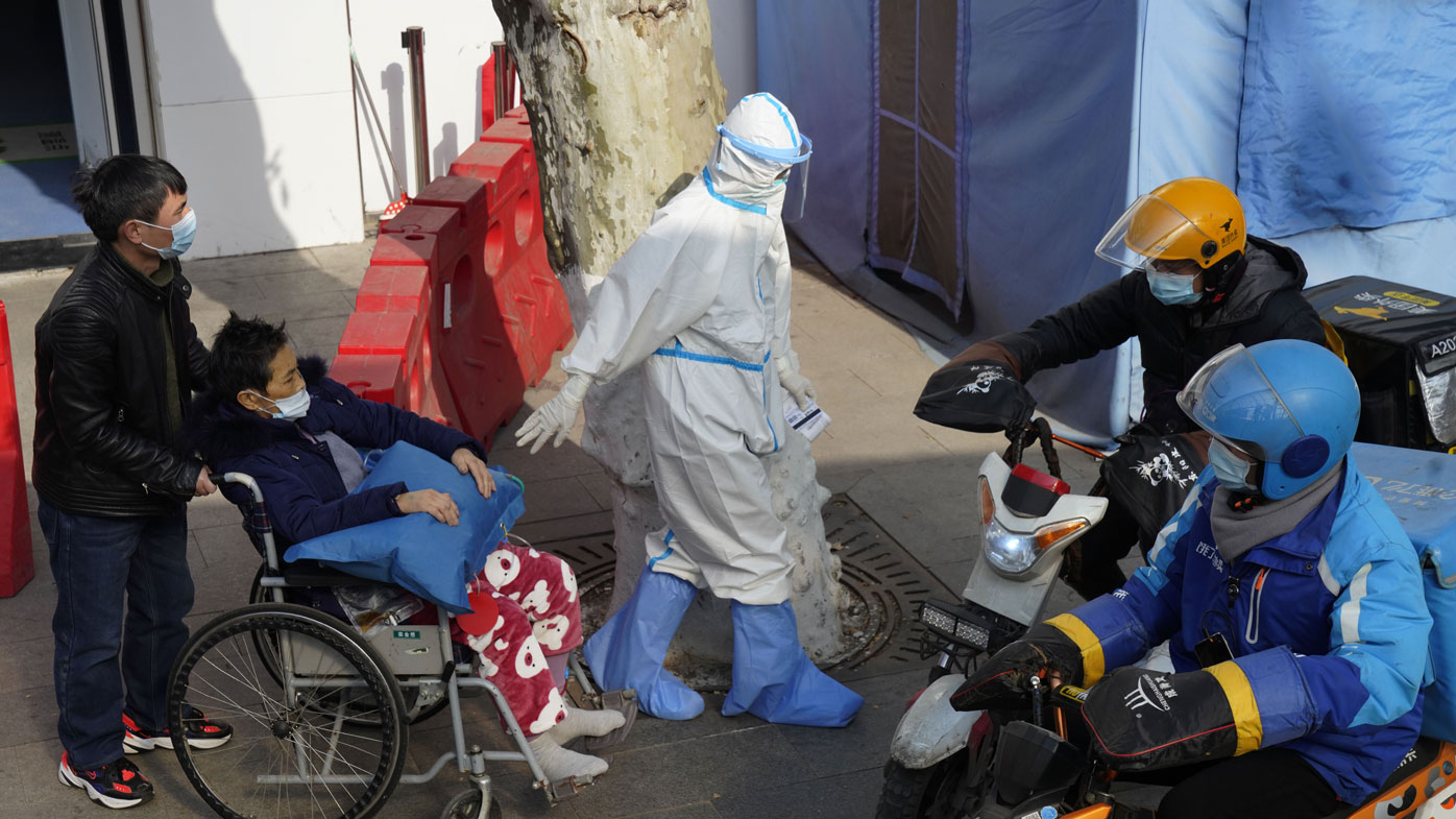 Wuhan scientists 'had virus symptoms before first confirmed cases'