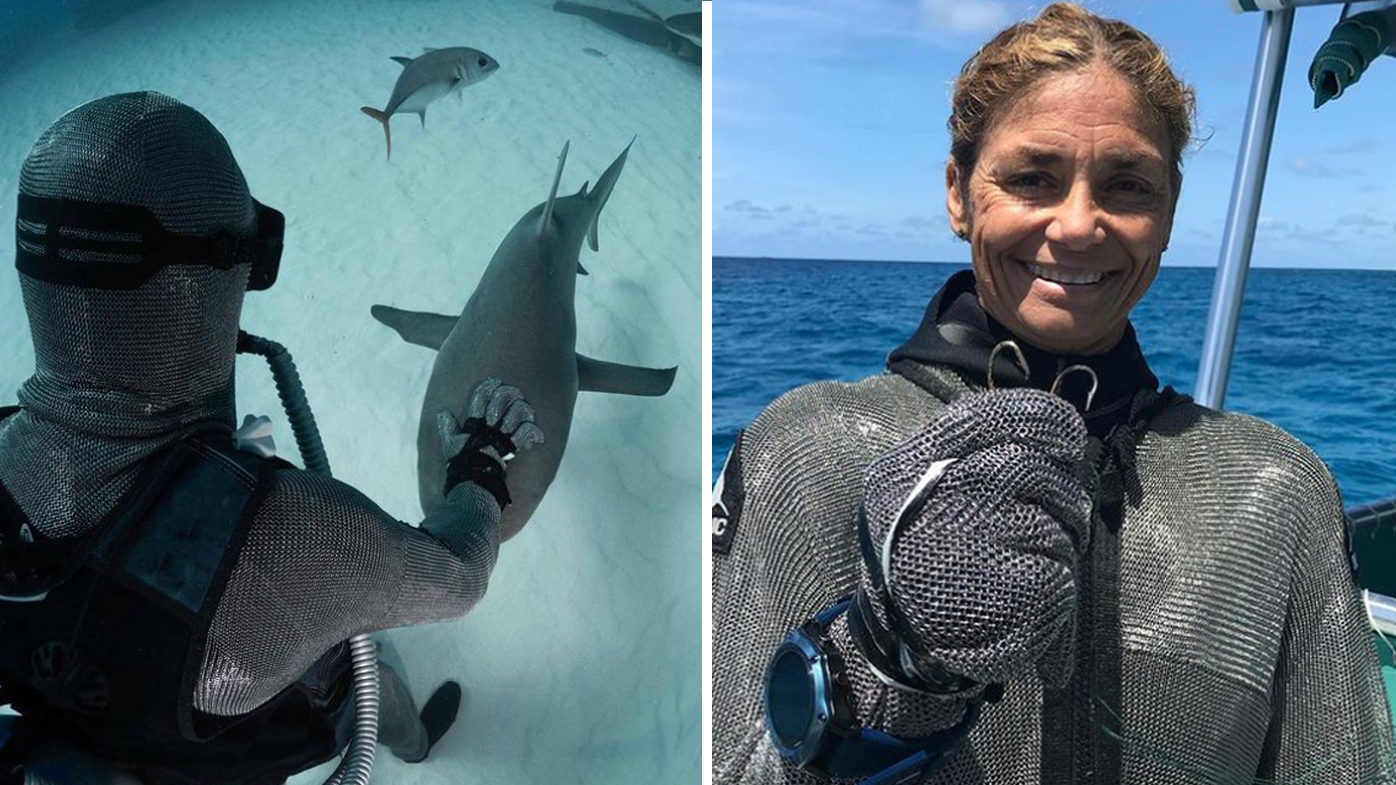 The diver said 'there's a level of trust' between her and the sharks as she works with the same population of animals.