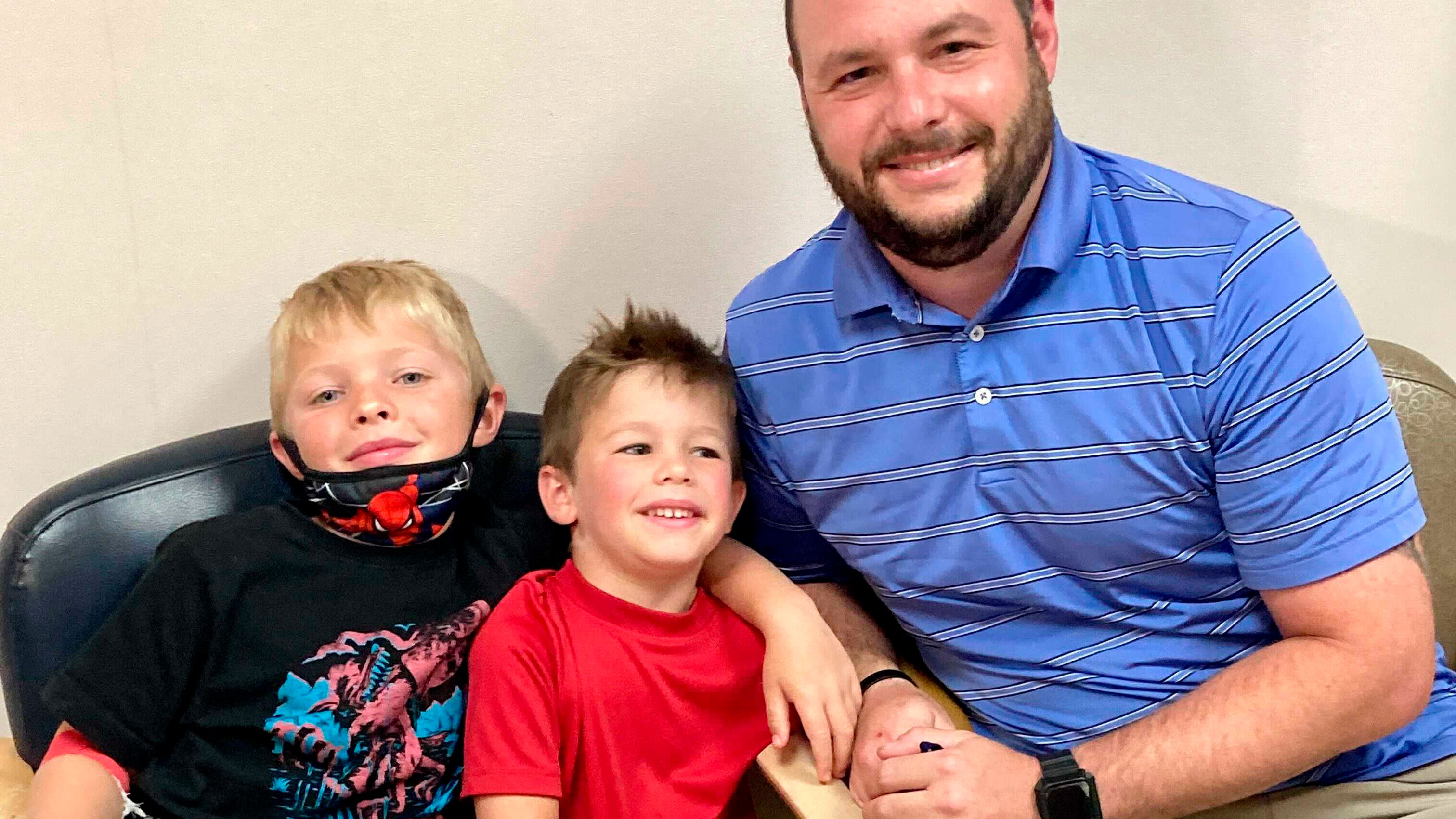 From left, 7-year-old Russell Bright, 5-year-old Tucker Bright, and dad Adam Bright pose for a picture at Ochsner Medical Center in Jefferson. Tests of Pfizer's COVID-19 vaccine started in Louisiana for children ages 5 through 11 in June.