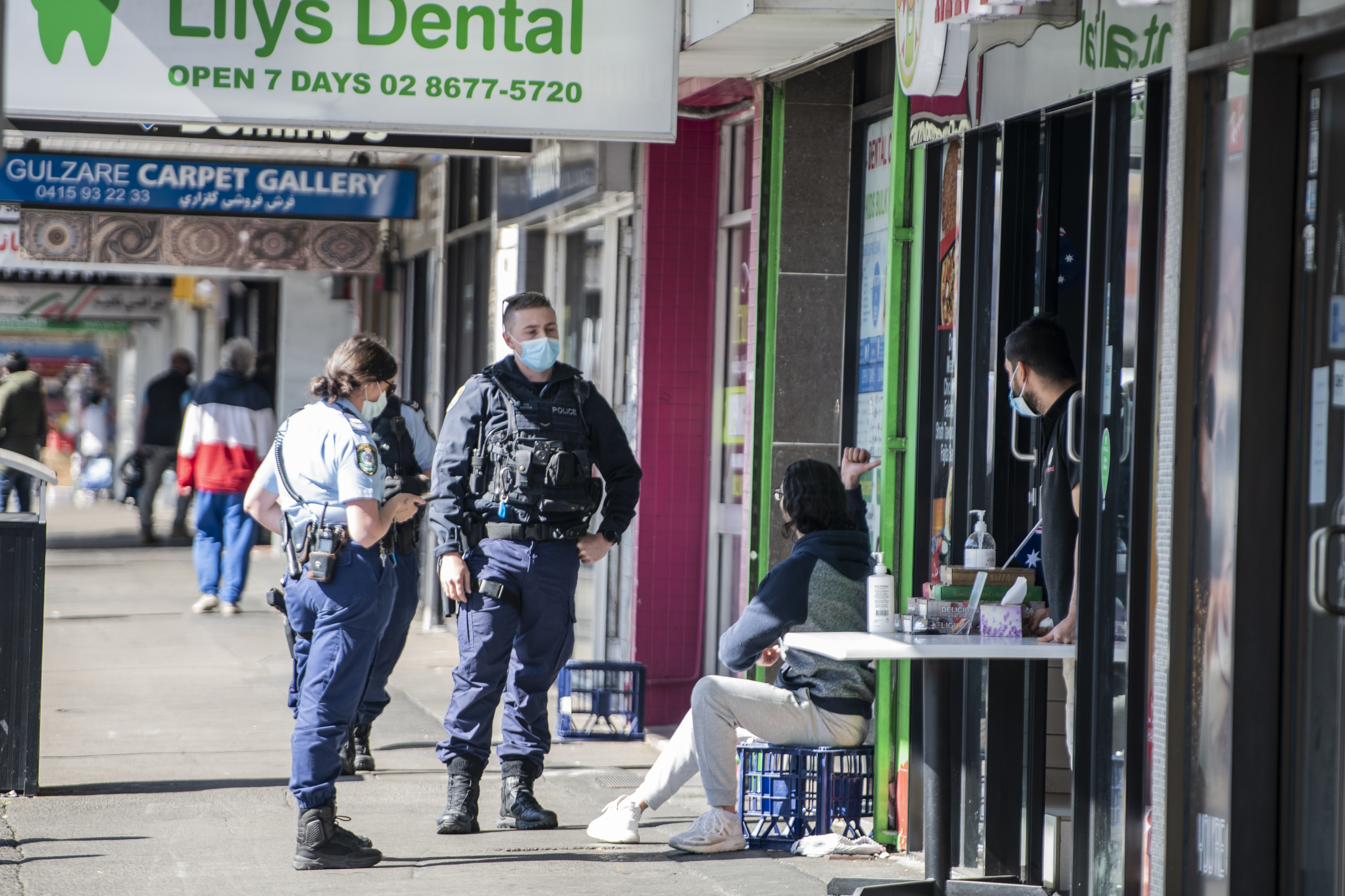 Police speaking to a man not wearing a mask, Merrylands Road, Merrylands on August 18.