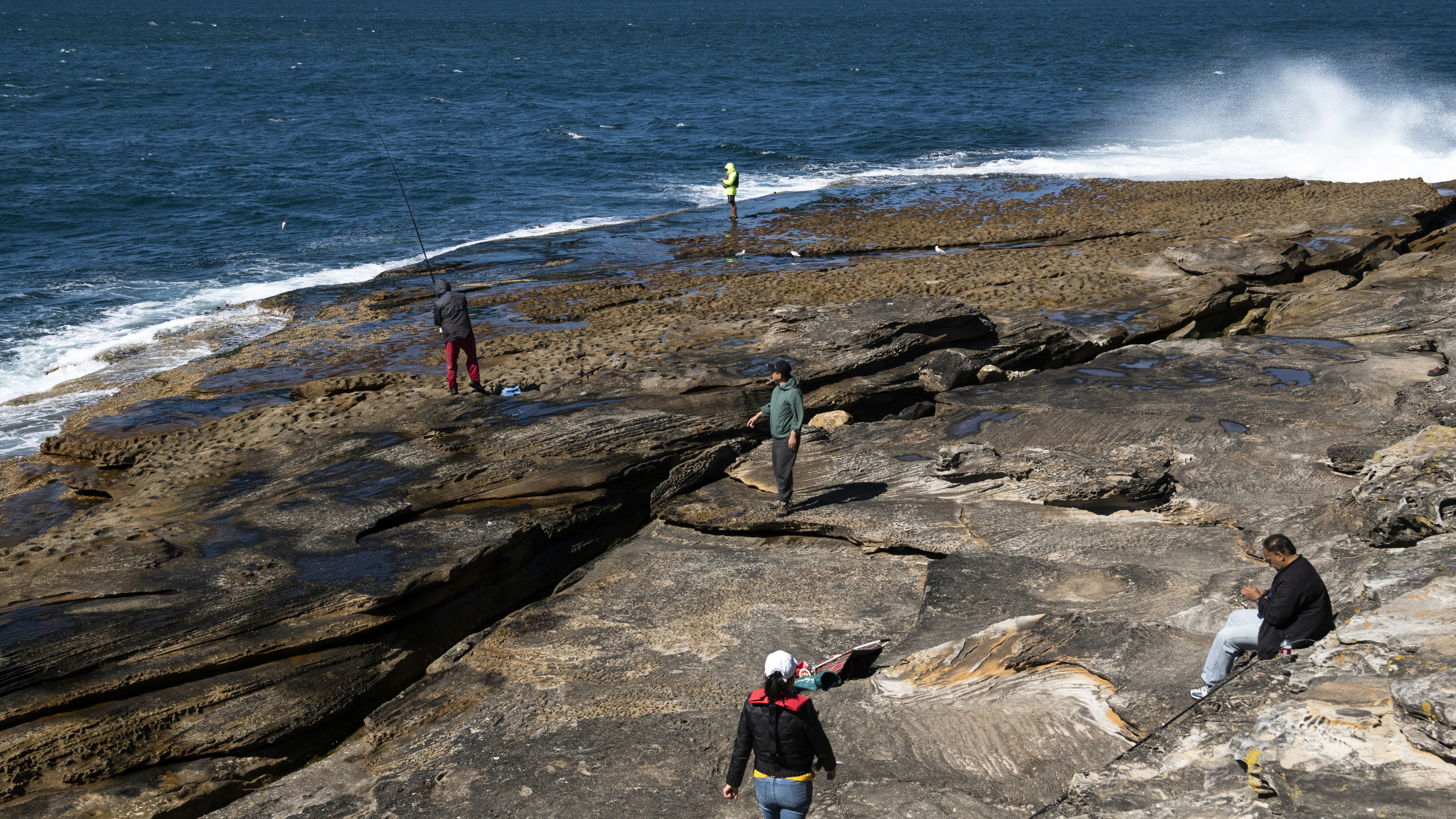 People fish during the lockout at La Perouse, Sydney.