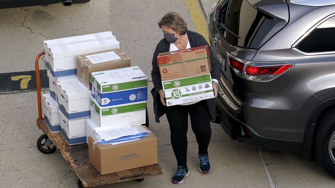 Election officials from around Dane County bring ballots in, Thursday, Nov., 19, 2020 to the Monona Terrace in Madison, Wis. for the recount that begins Friday