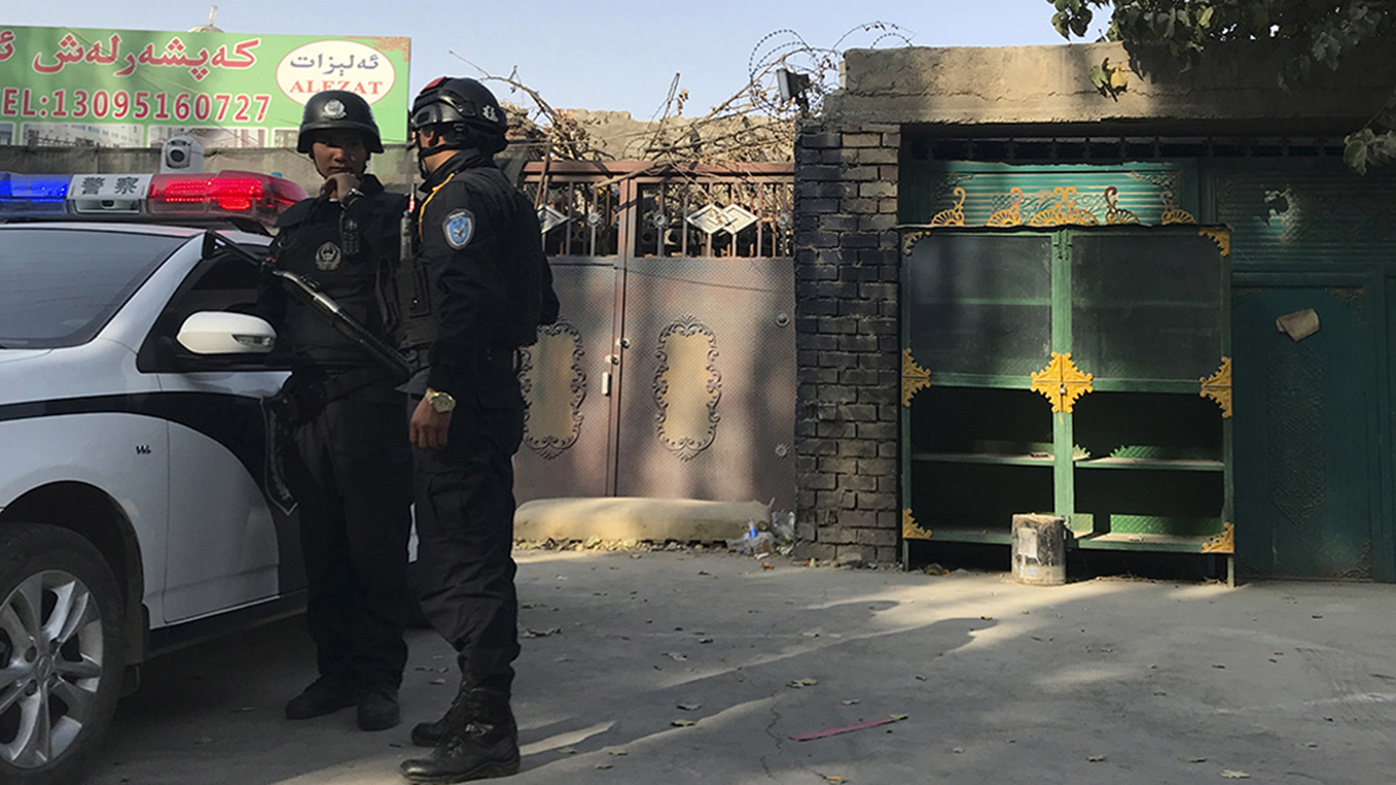 Police officers on duty in the vicinity of a centre believed to be used for re-education in Korla in western China's Xinjiang region.