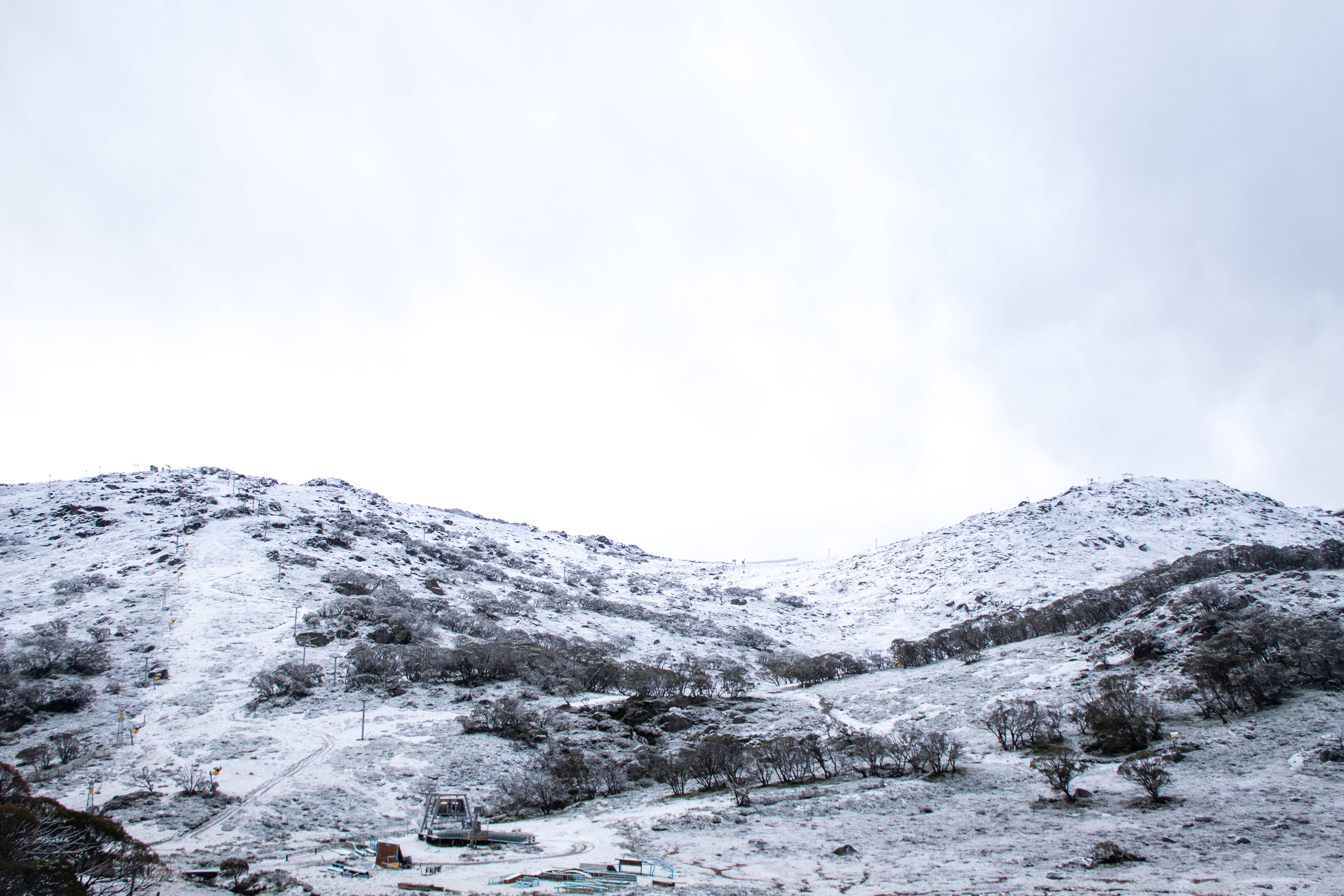 Wintery snap brings snow and torrential rain