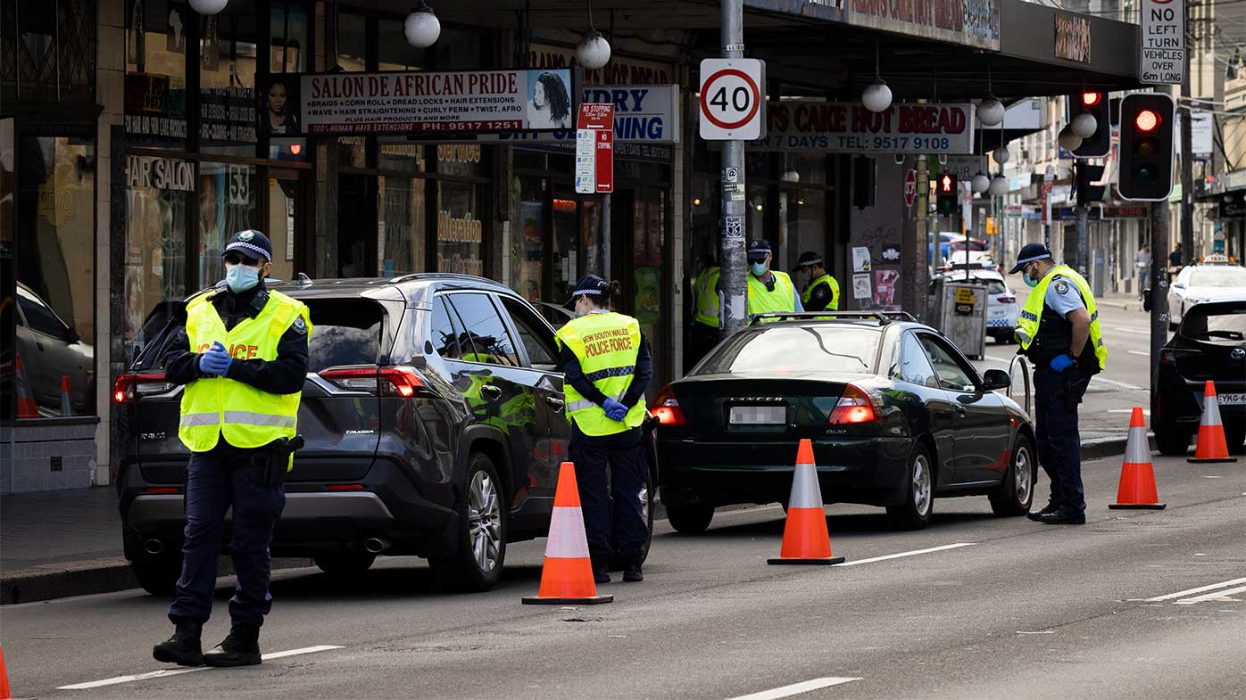 Police check drivers on Enmore Road to ensure they aren't out of the house illegally.