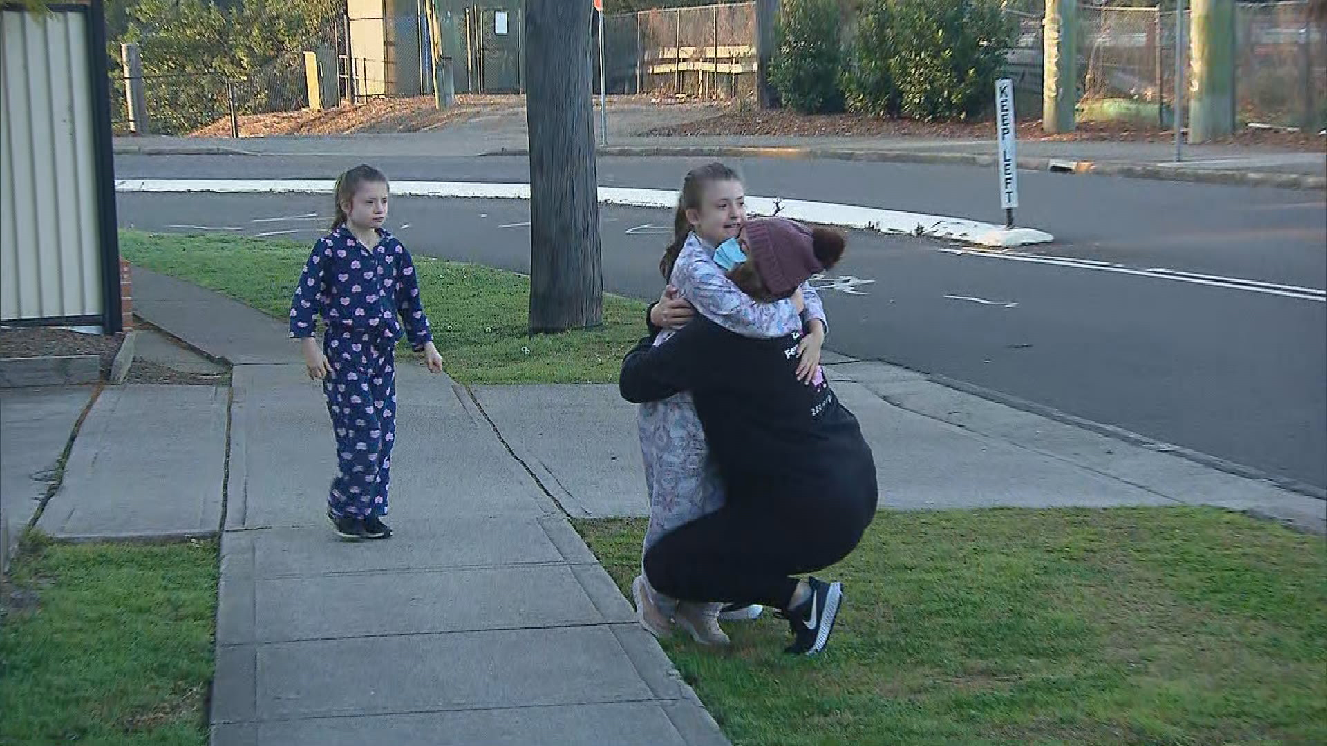 Michelle being reunited with her twin daughters after she was locked down in her Blacktown apartment for two weeks.
