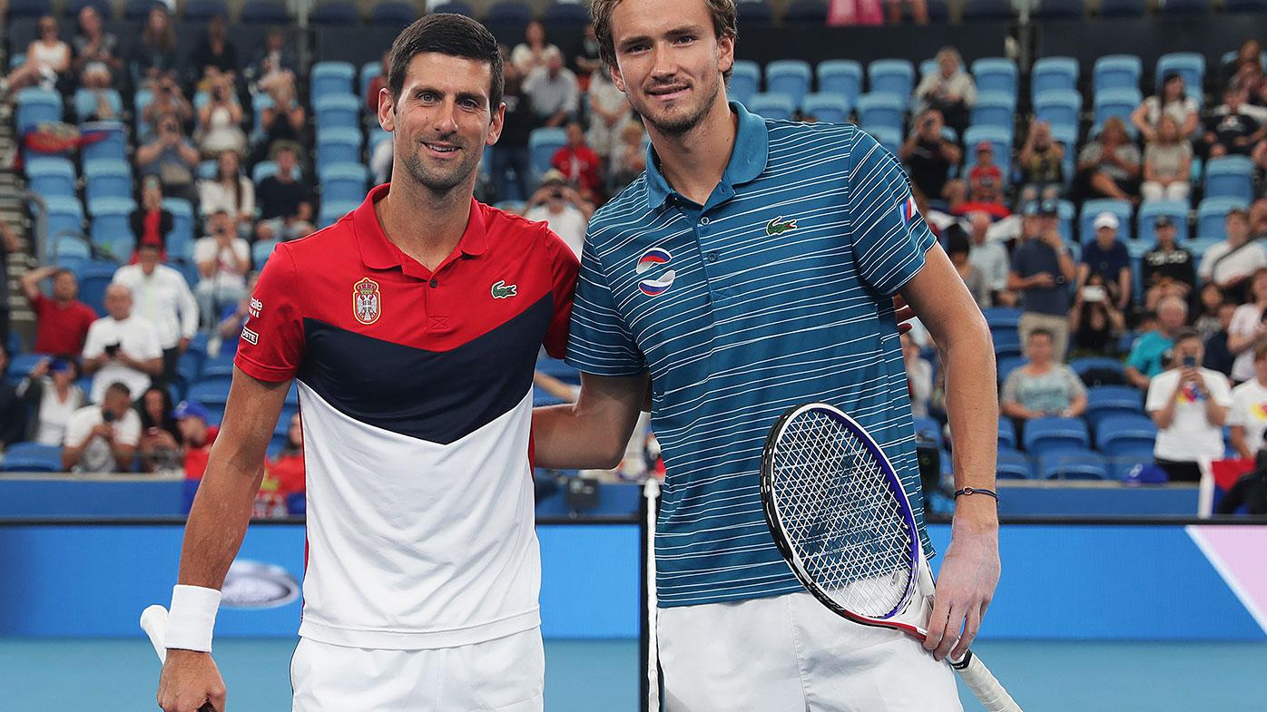 Novak Djokovic with Daniil Medvedev.