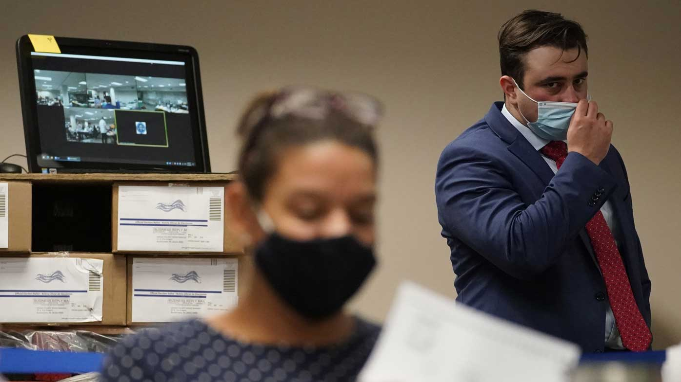 A Republican observer watches ballots being counted in Allentown, Pennsylvania.