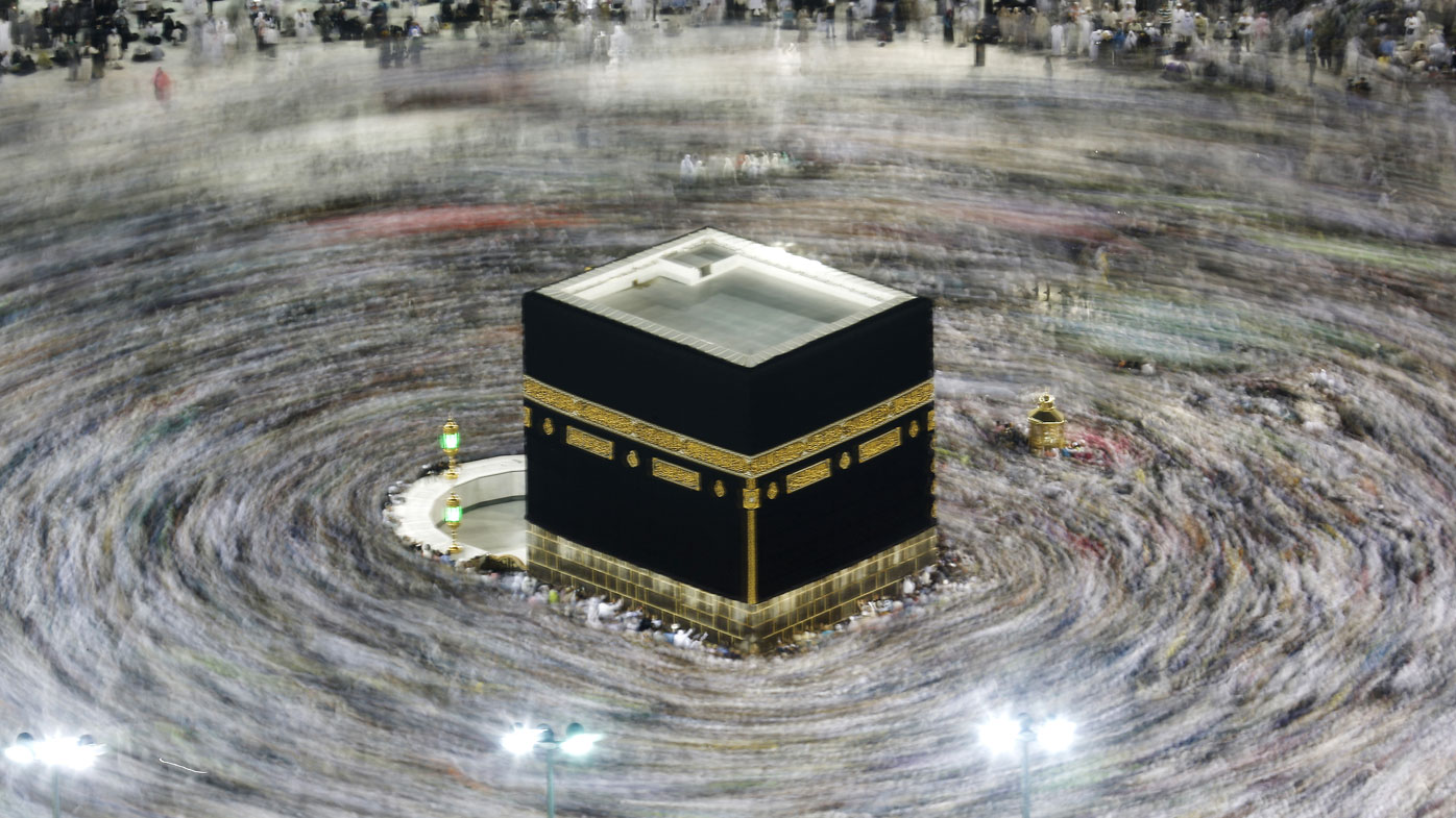 FILE - In this Aug. 13, 2019, file photo taken with a slow shutter speed, Muslim pilgrims circumambulate the Kaaba, the cubic building at the Grand Mosque, during the hajj pilgrimage in the Muslim holy city of Mecca, Saudi Arabia.