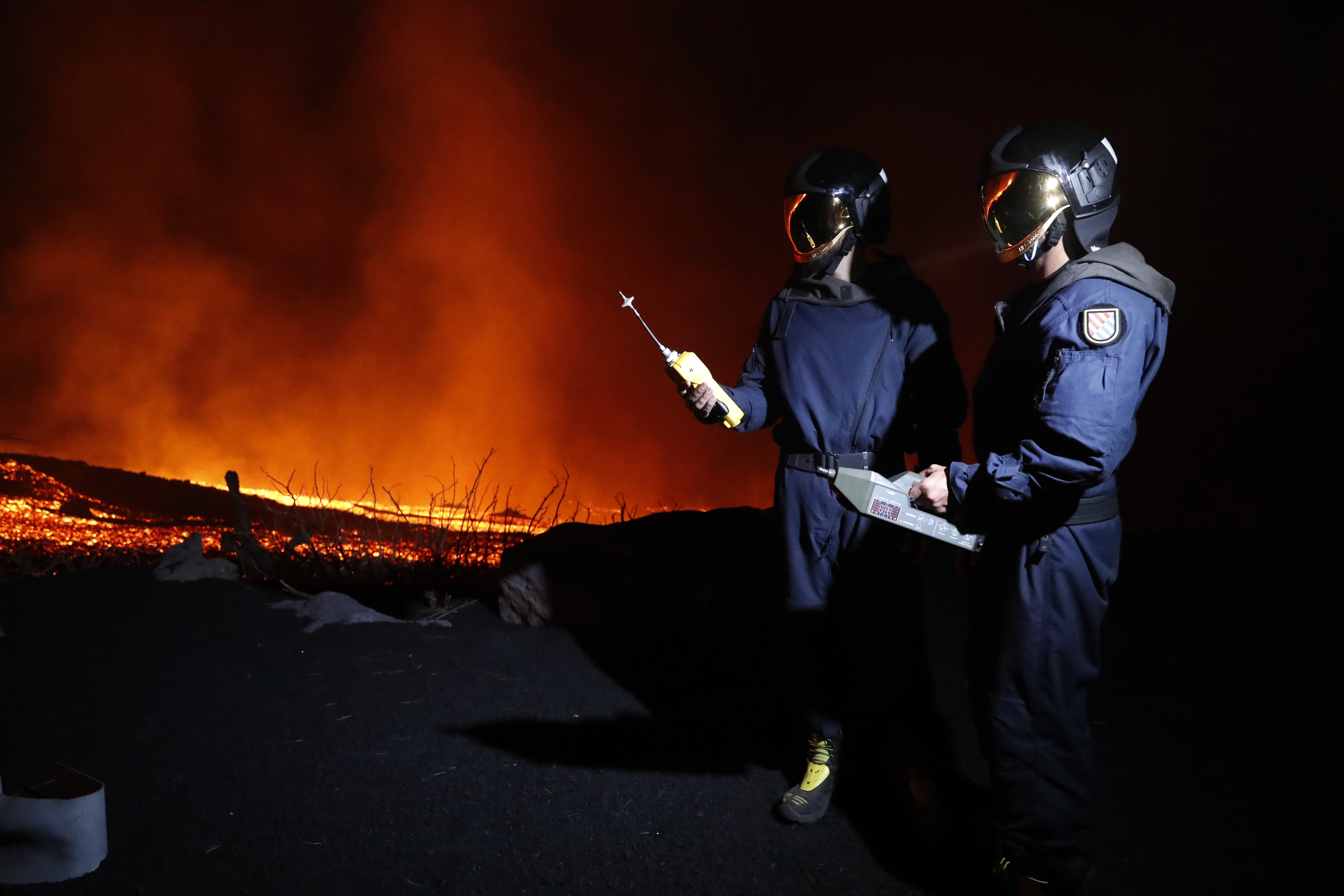 Military Emergency Unit personal take gas reading measurements near a volcano on the Canary island.