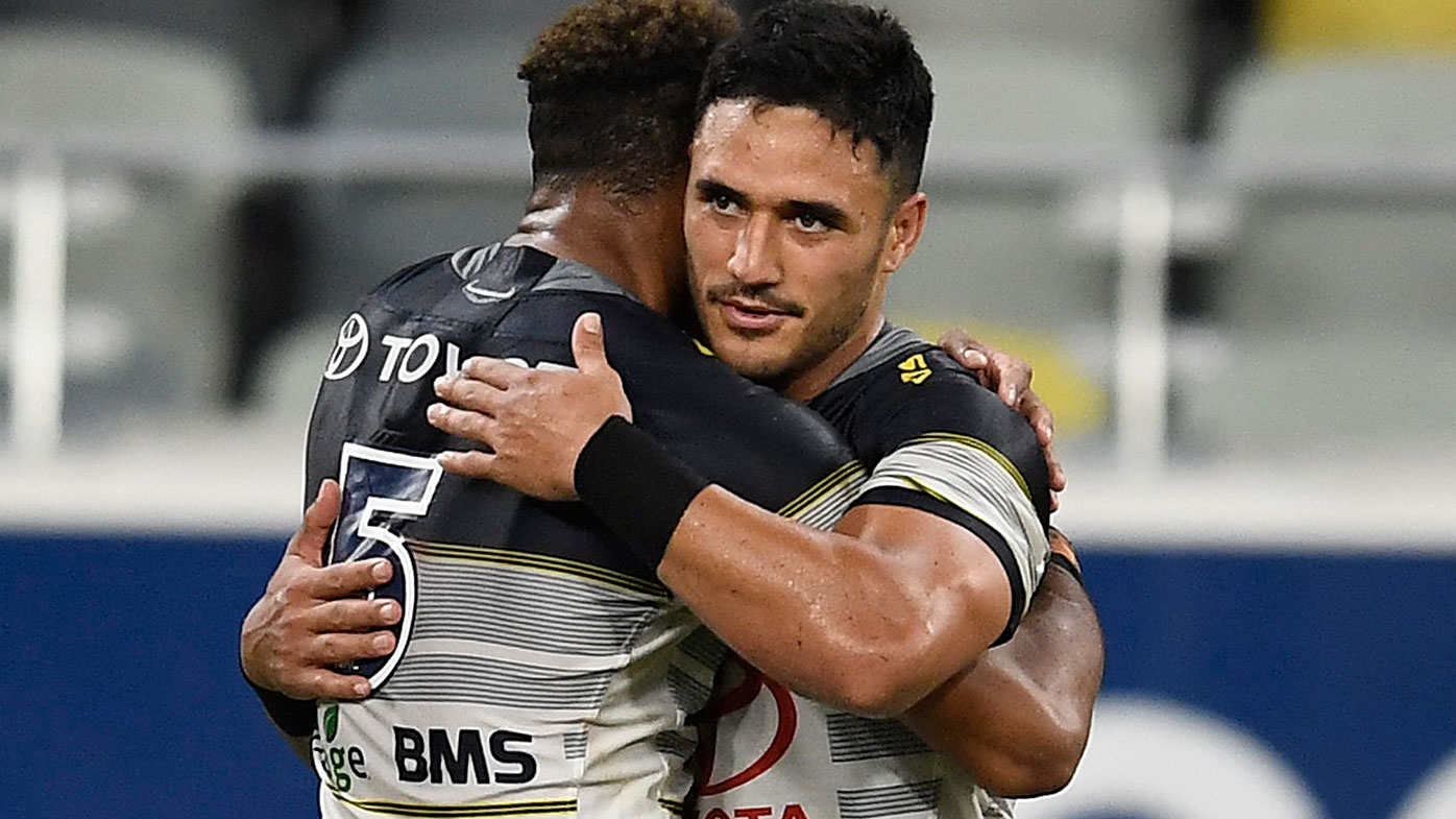 Hamiso Tabuai-Fidow and Valentine Holmes of the Cowboys embrace after winning the round 17 NRL match between the North Queensland Cowboys and the St George Illawarra Dragon