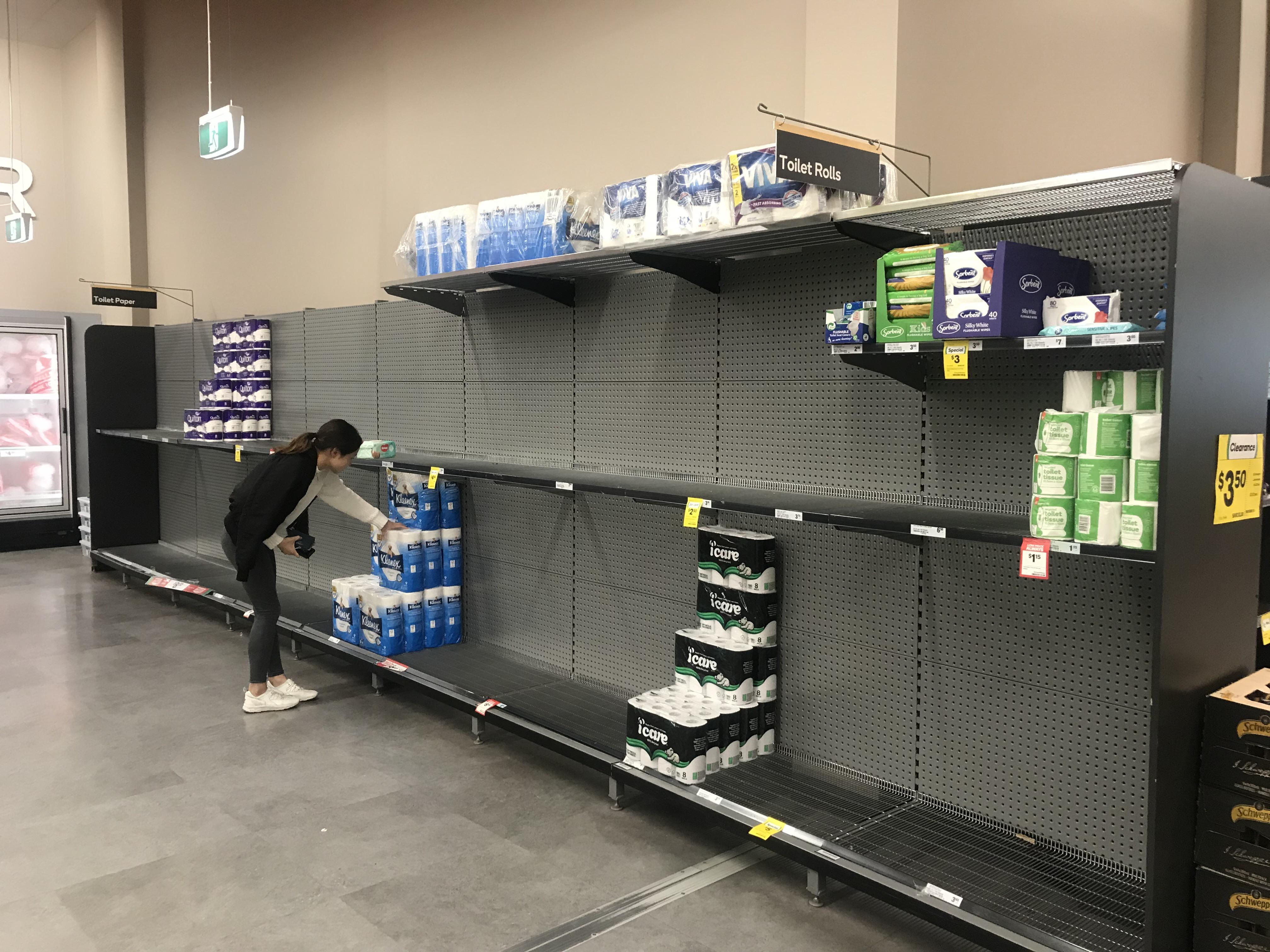 Supermarket shelves in Alexandria stripped of toilet paper.