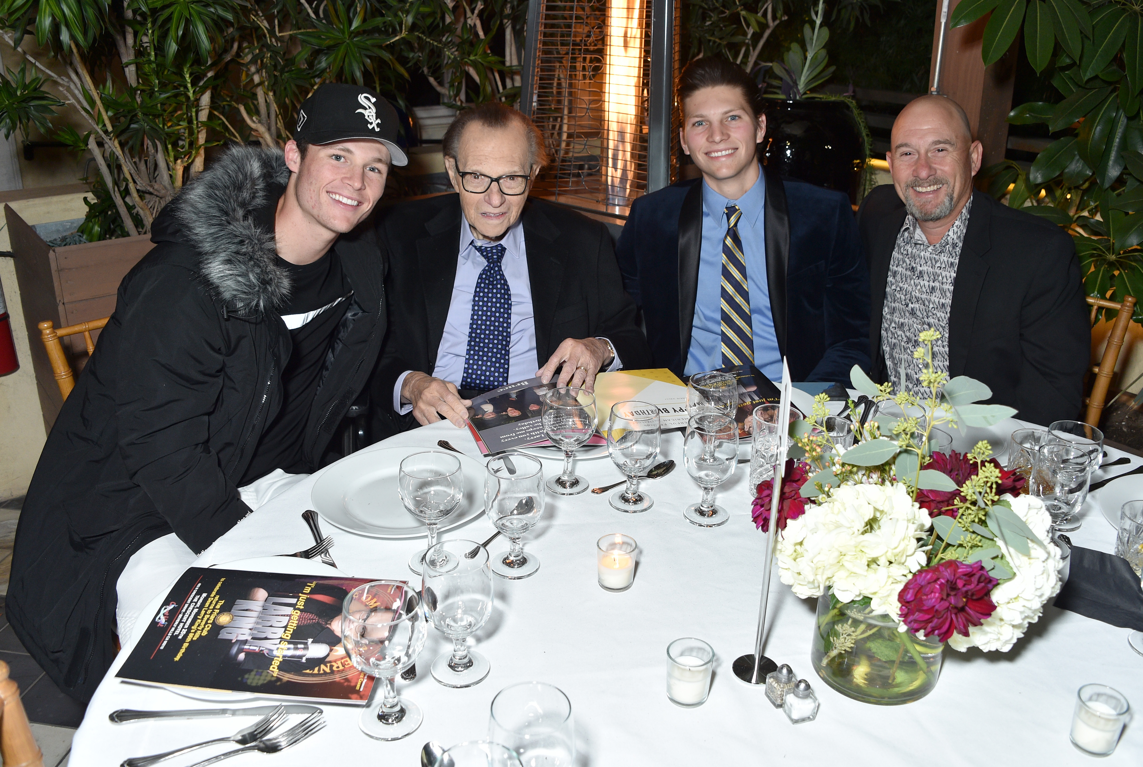 Cannon Edward King, Larry King, Chance Armstrong King and Larry King Jr. attend the Friars Club honors Larry King for his 86th birthday at The Crescent Hotel on November 25, 2019 in Beverly Hills, California.