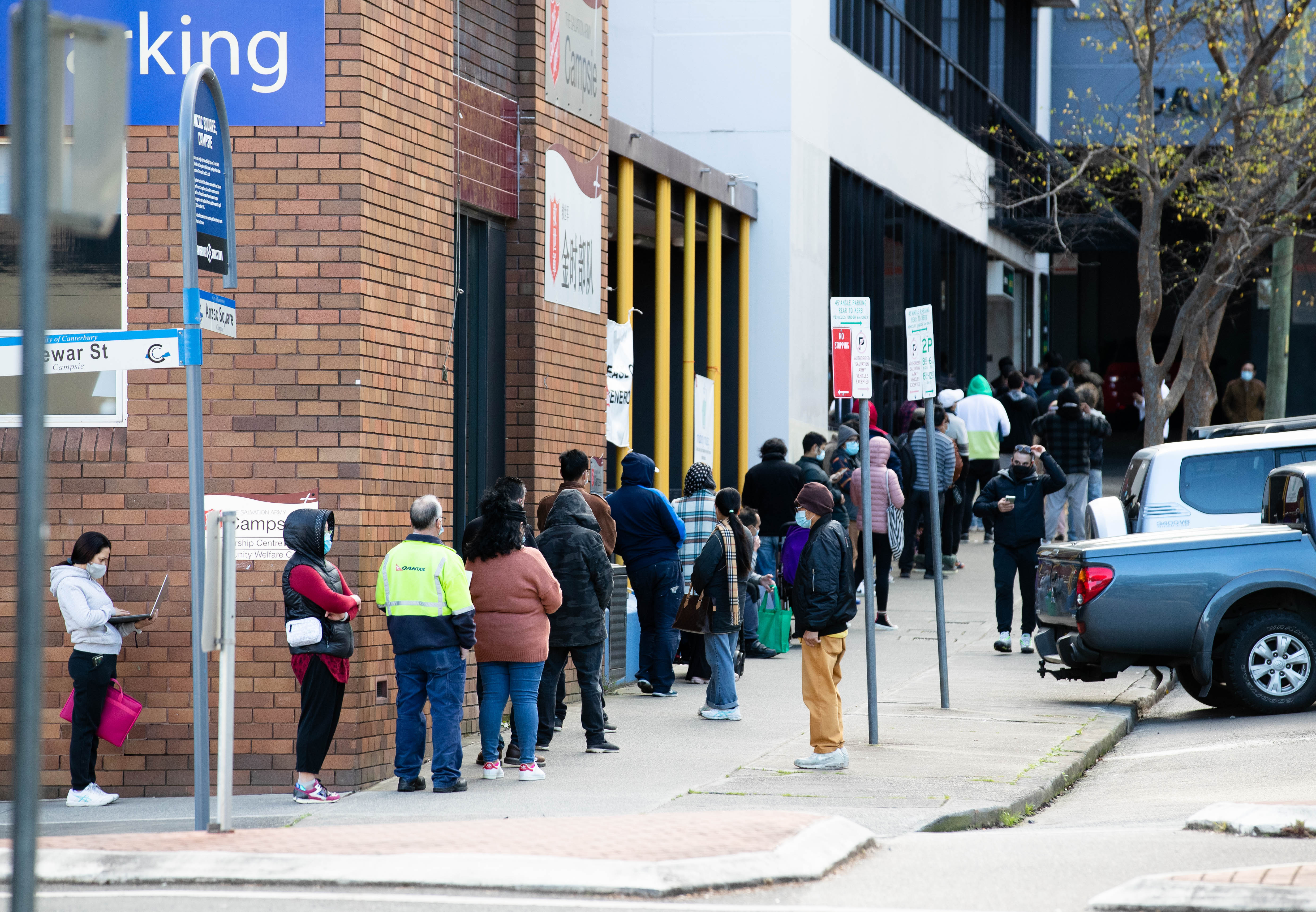 The queue for Centrelink in Campsie, in Sydney's inner-west, stretches down the street, during Sydney's lockdown.
