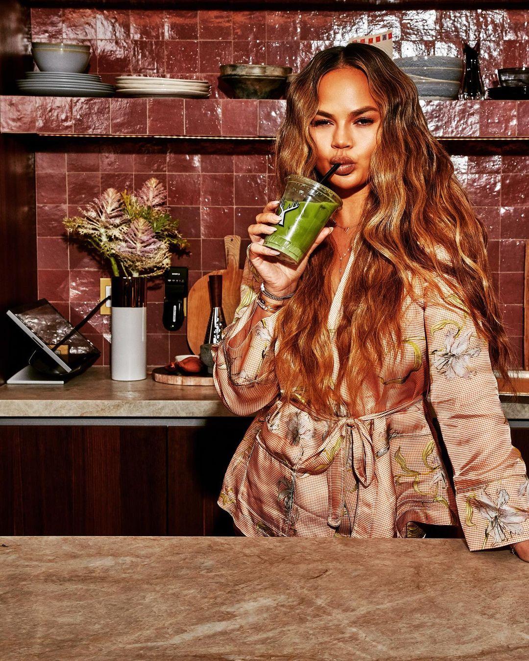 Chrissy Teigen, drinking smoothie, photoshoot