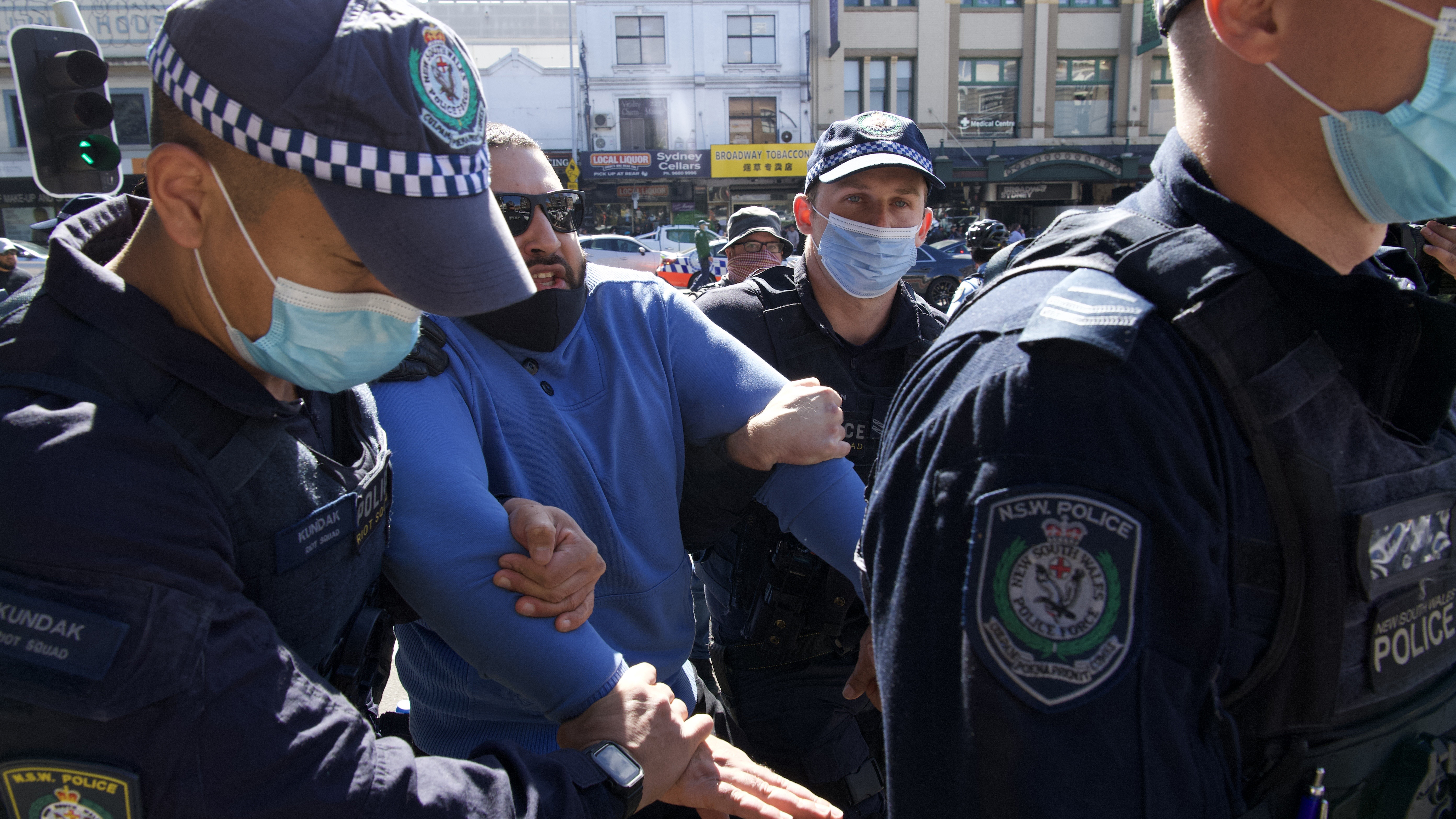 A man is held by police on Broadway, Sydney.