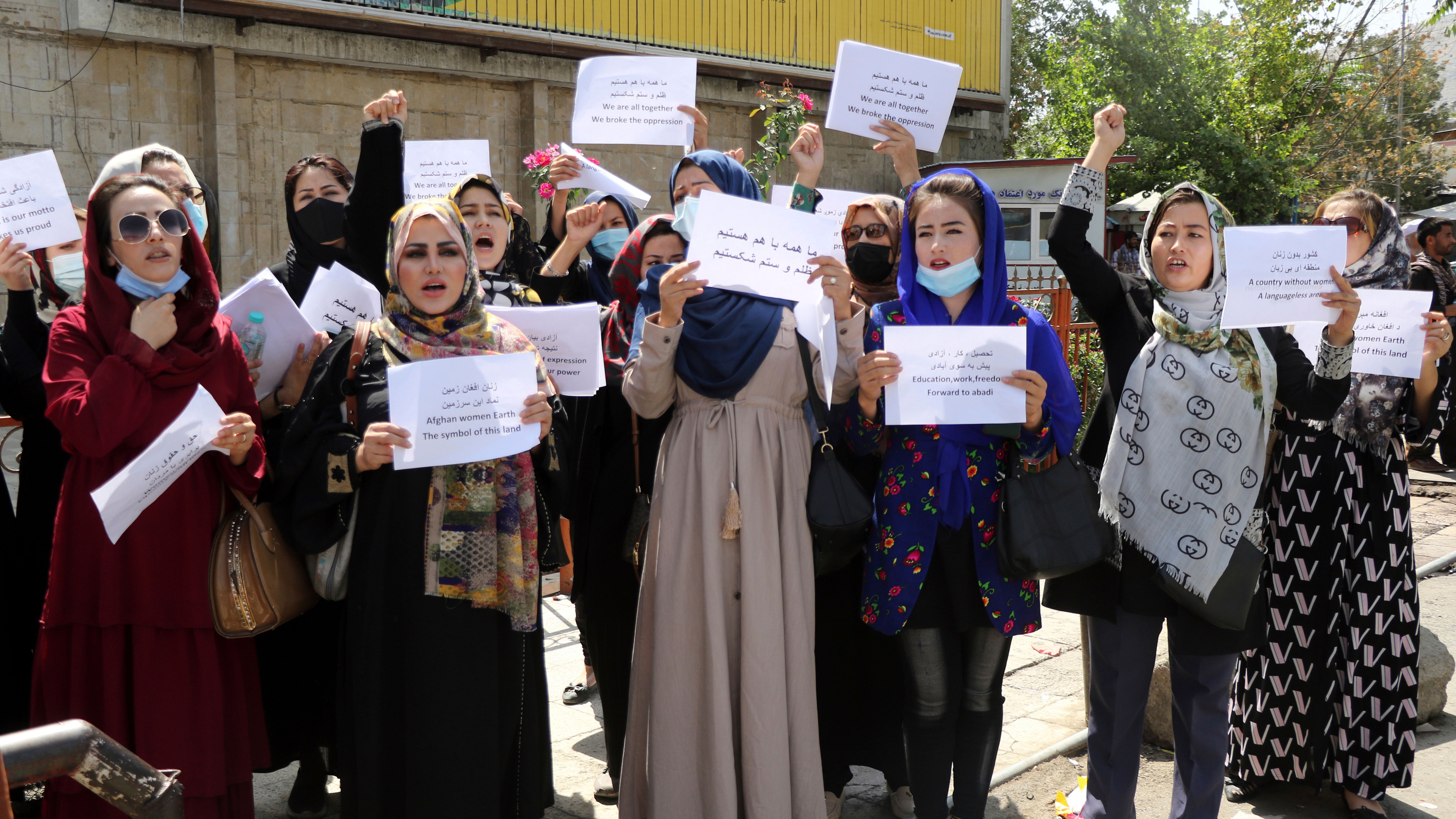 Women gather to demand their rights under the Taliban rule during a protest in Kabul, Afghanistan.
