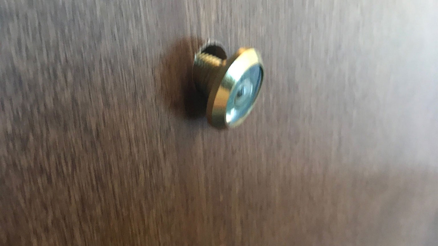 Nathan and Christina Parks say they found the peephole on the floor outside their hotel room.