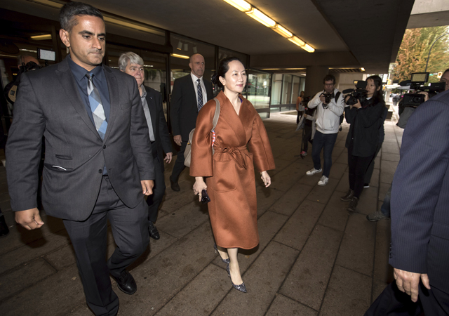 Huawei chief financial officer Meng Wanzhou, who is out on bail and remains under partial house arrest after she was detained last year at the behest of American authorities, leaves court during a lunch break from a hearing, in Vancouver.