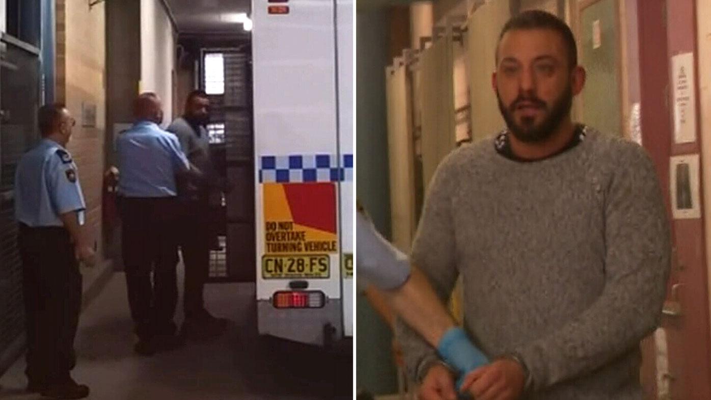 Handcuffed fugitive's crude gesture after arrest