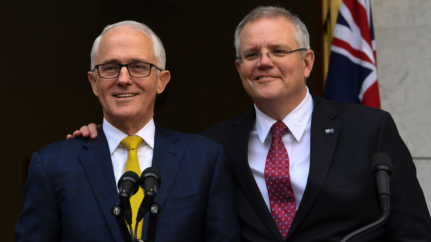 Morrison smiles alongside Turnbull days before he was ousted as leader of the Liberal Party.