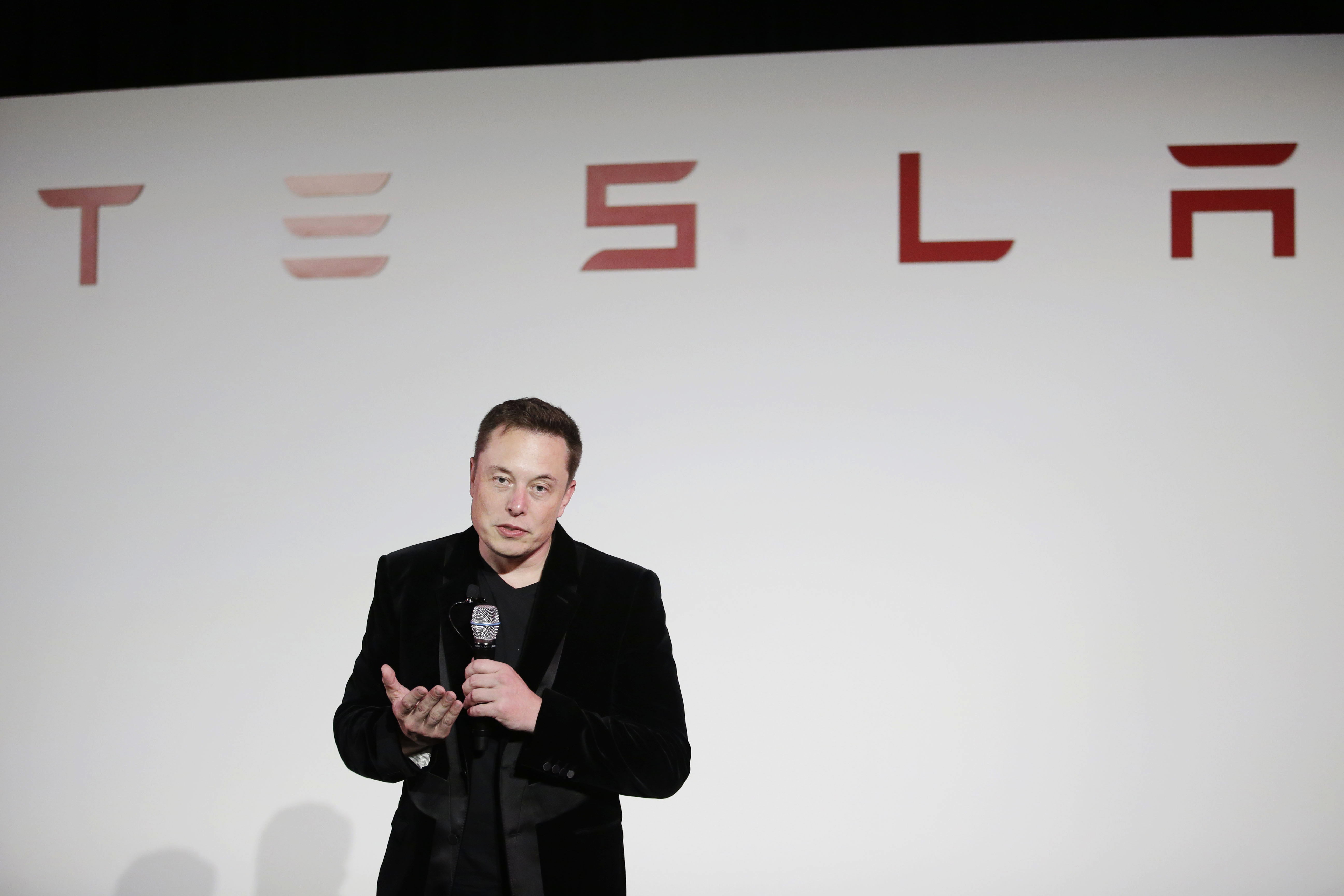 Elon Musk, CEO of Tesla Motors Inc., talks about the Model X car at the company's headquarters  Tuesday, Sept. 29, 2015, in Fremont, California.