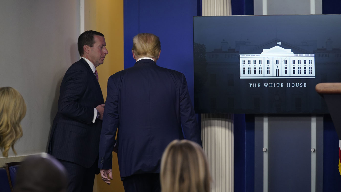 Trump walks out after being asked about doctor's alien DNA theories