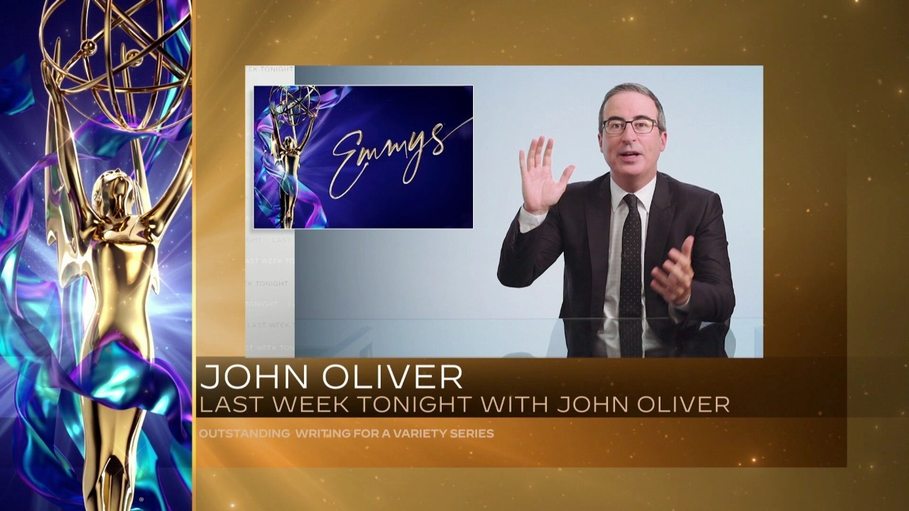 """John Oliver accepts the Emmy for Outstanding Writing For A Variety Series for """"Last Week Tonight With John Oliver"""" at 2021 Creative Emmy Awards."""