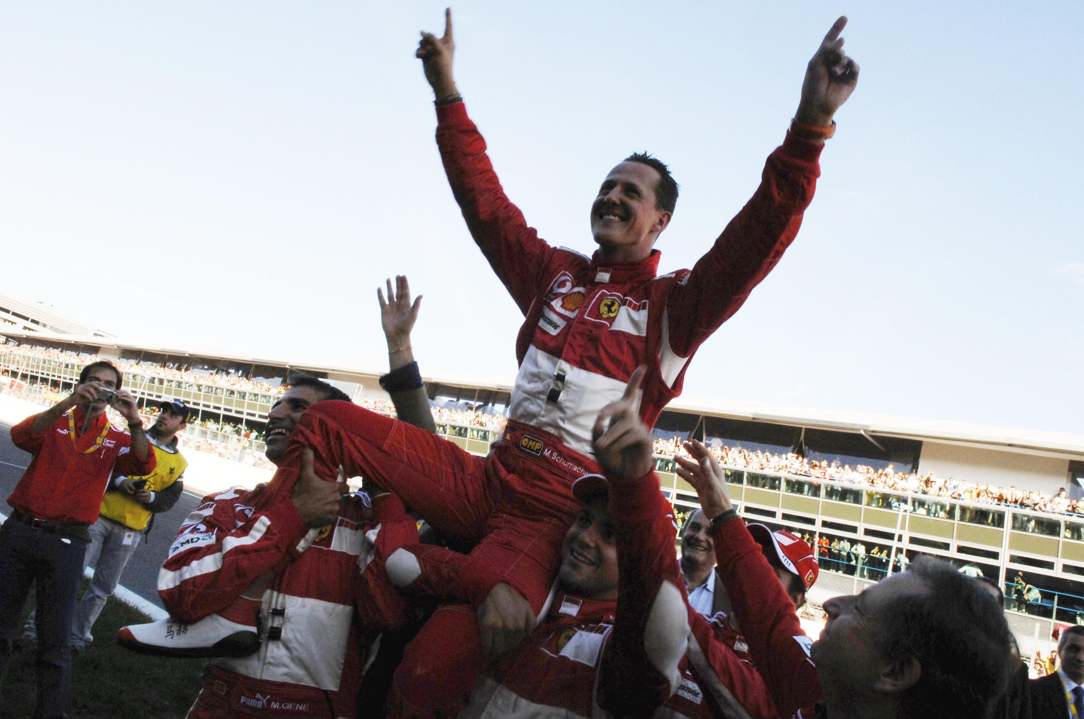 German Ferrari driver Michael Schumacher waves to fans in 2006.