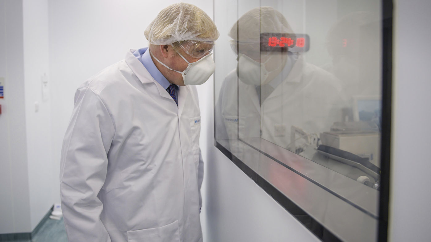 Britain's Prime Minister Boris Johnson visits the French biotechnology laboratory Valneva in Livingston, Scotland, Thursday Jan. 28, 2021, where they will be producing a COVID-19 vaccine on a large scale, during a visit to Scotland