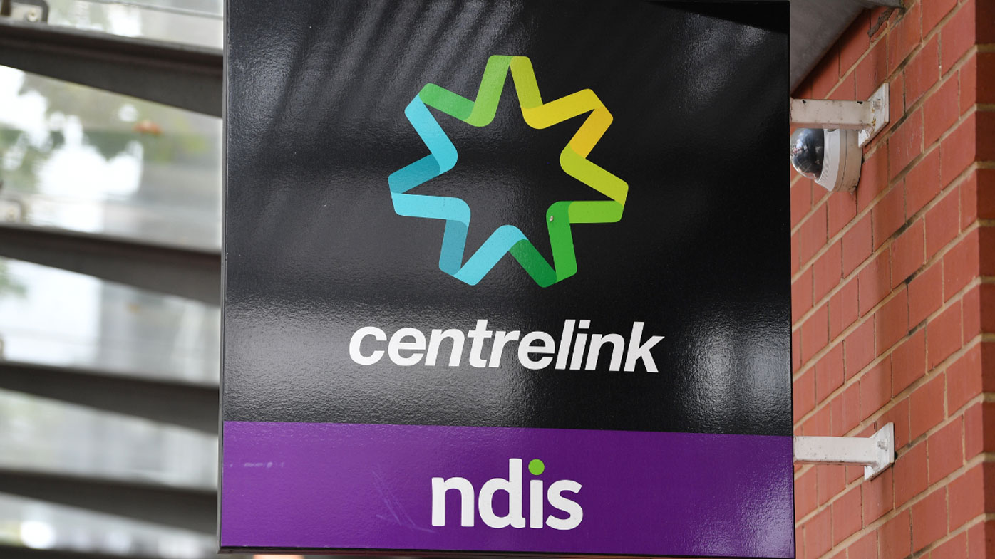 Man charged after allegedly coughing on Centrelink security guard
