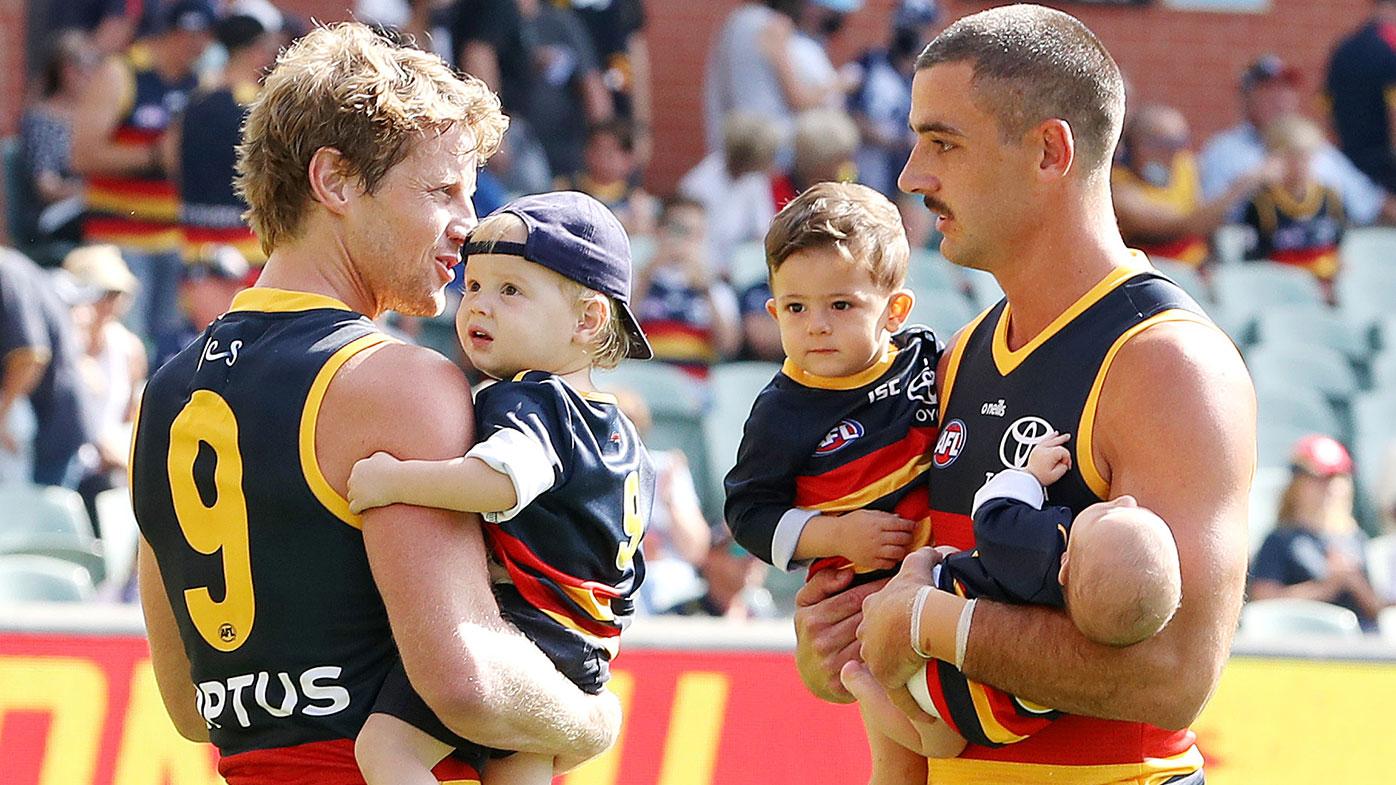 ADELAIDE, AUSTRALIA - MARCH 20: Rory Sloane of the Crows and team mate Taylor Walker with their children before the 2021 AFL Round 01 match between the Adelaide Crows and the Geelong Cats at Adelaide Oval on March 20, 2021 in Adelaide, Australia. (Photo by Sarah Reed/AFL Photos via Getty Images)
