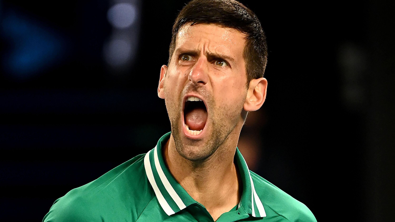 Novak Djokovic yells at the Rod laver Arena crowd.