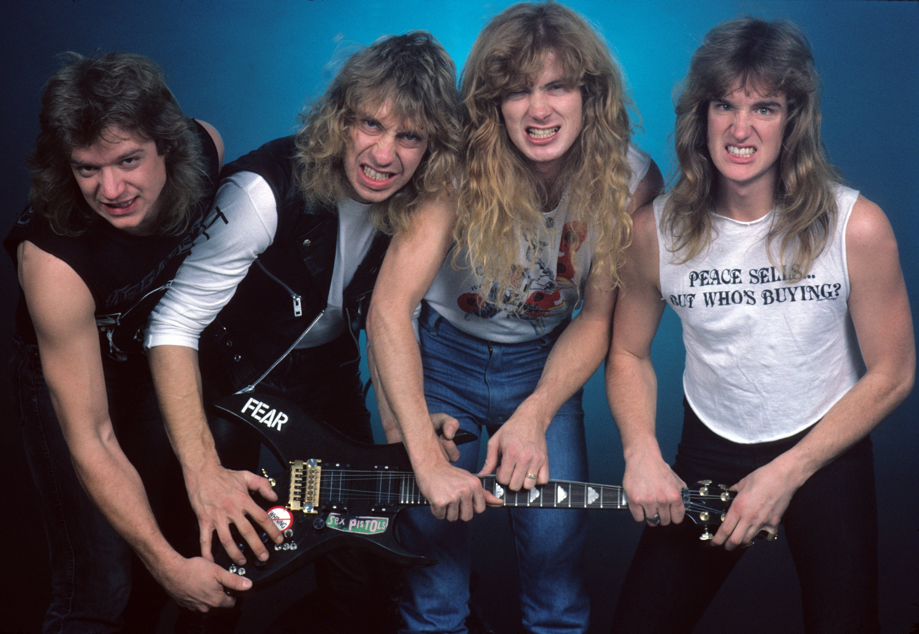 """Chris Poland, Gar Samuelson, Dave Mustaine and David Ellefson of the heavy metal band """"Megadeth"""" pose for a portrait holding a guitar in 1986 in New York City, New York."""