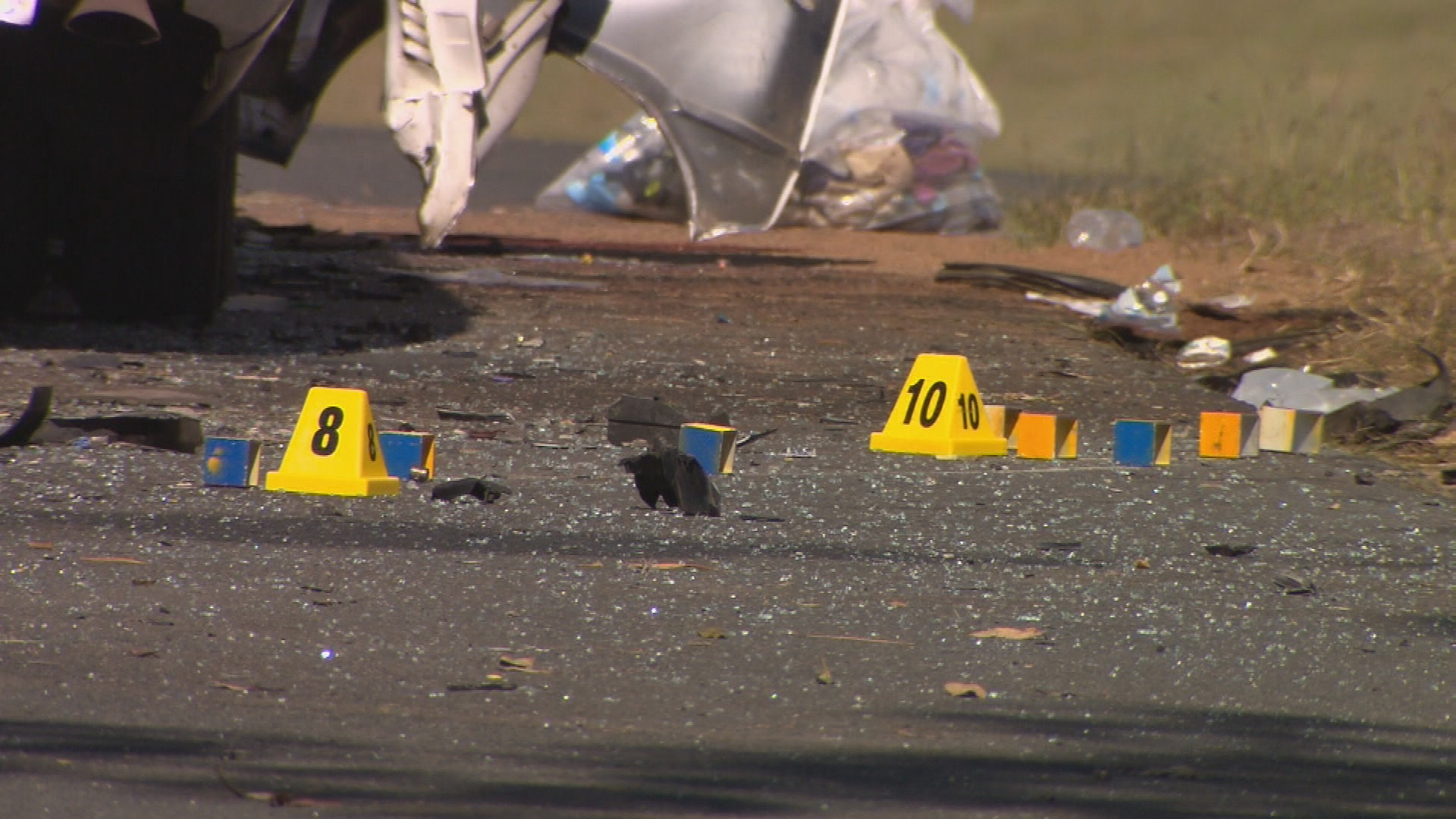 Glass and debris were strewn across the road, which was closed for most of the day.