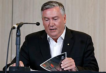 Eddie McGuire reading racism report (Getty)