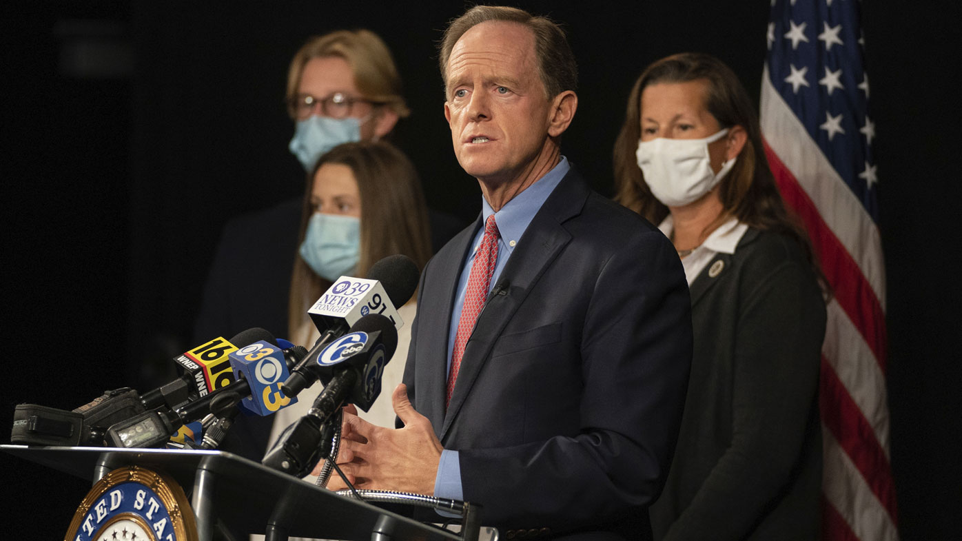 Republican US Sen. Pat Toomey, of Pennsylvania, announces he won't seek reelection or run for governor during a news conference with his family, Monday, Oct. 5, 2020 at PPL Public Media Center, in Bethlehem, Pa