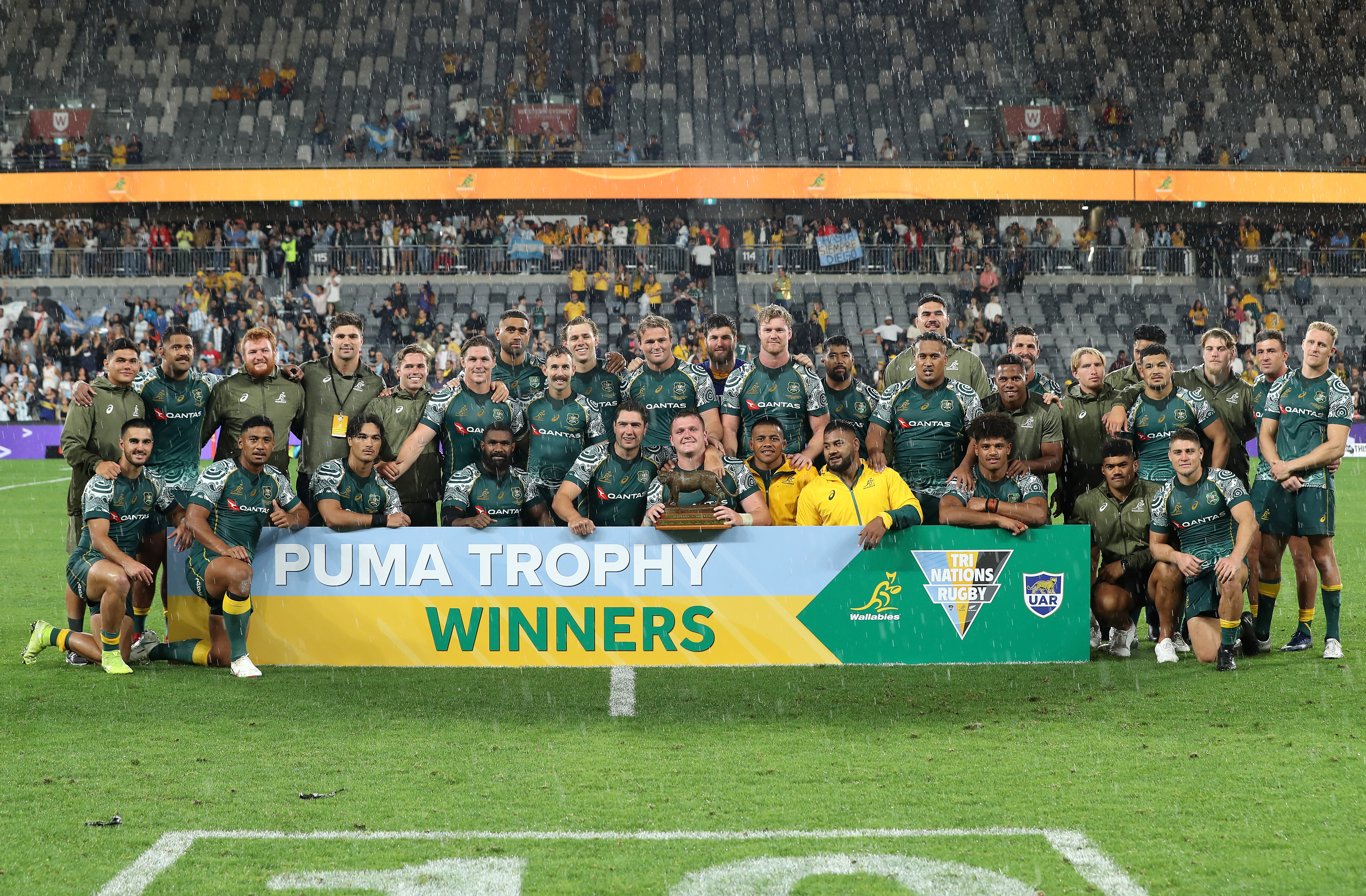 The Wallabies pose with the Puma Trophy.