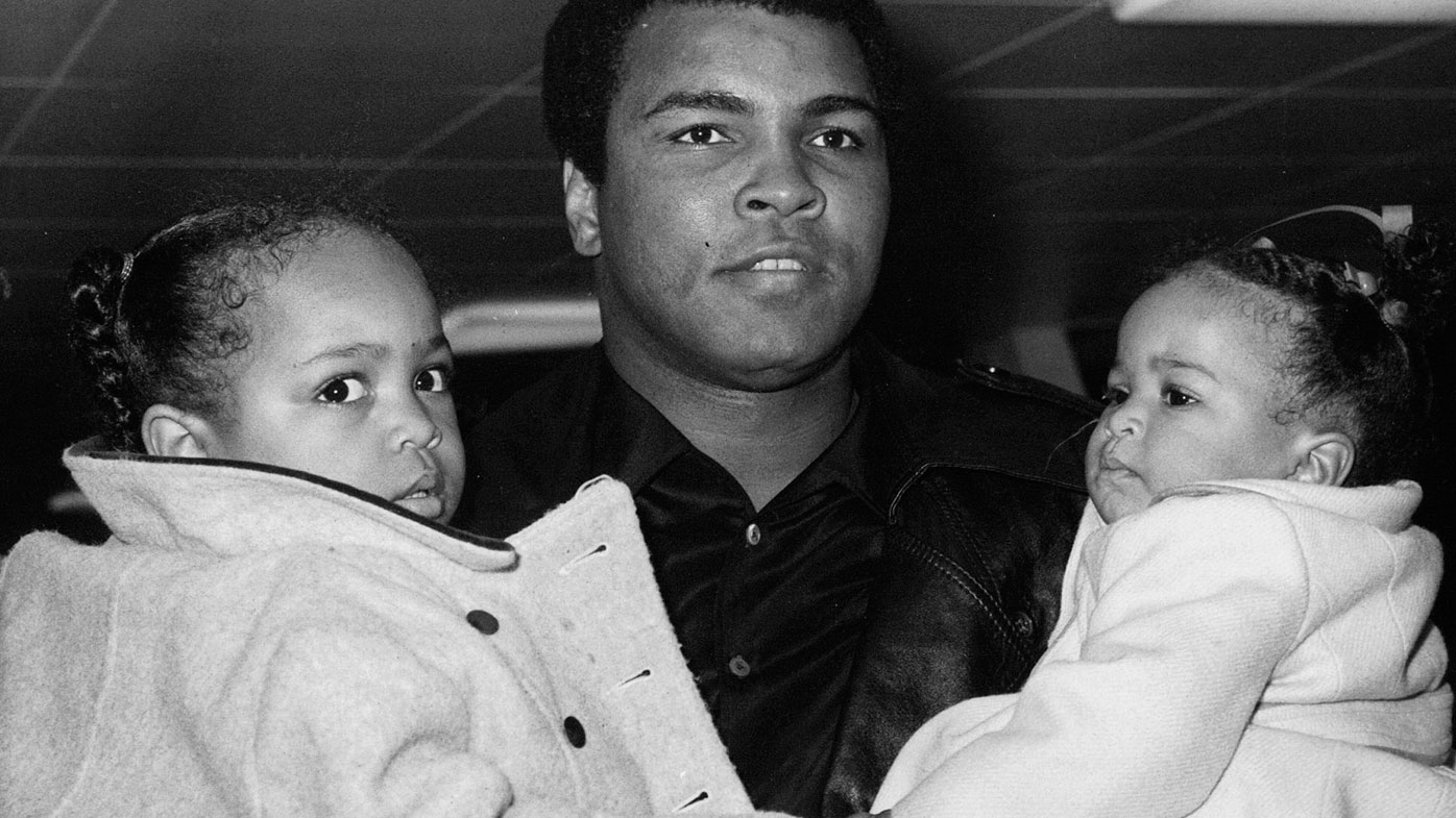 In this Dec. 20, 1978, file photo, World heavyweight champion Muhammad Ali carries his daughters, 2-year-old Hana, left, and nine-month-old Laila